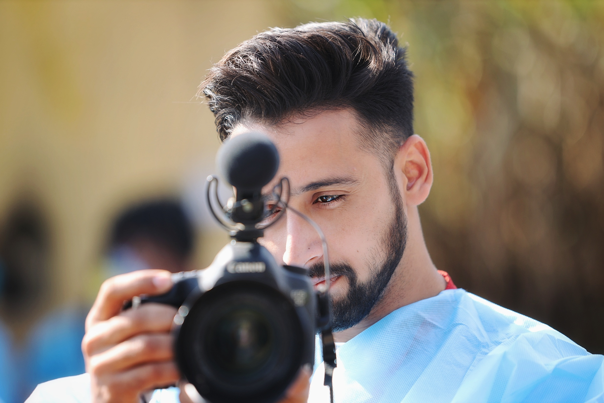 Boy clicking picture with the camera