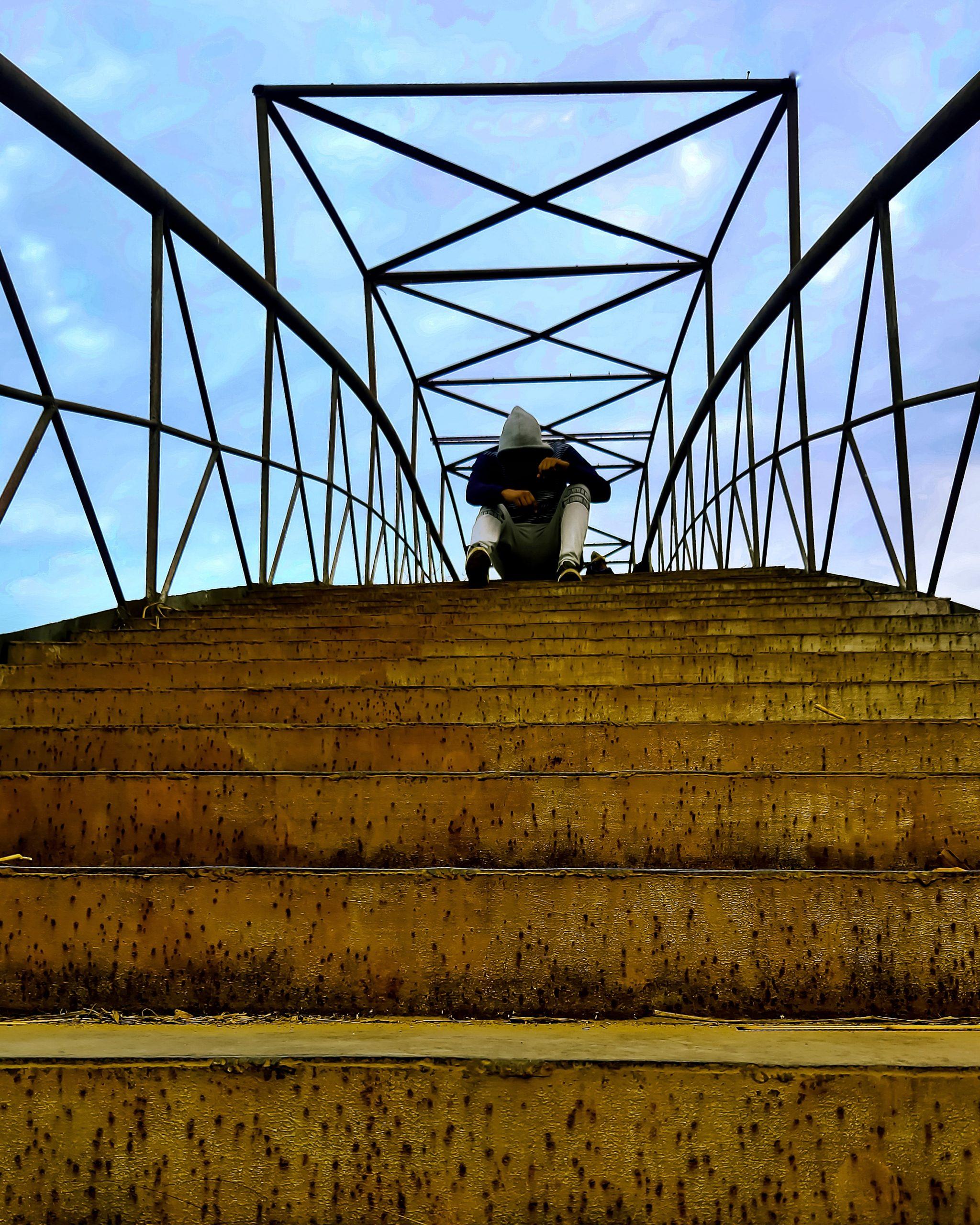 Boy posing on bridge
