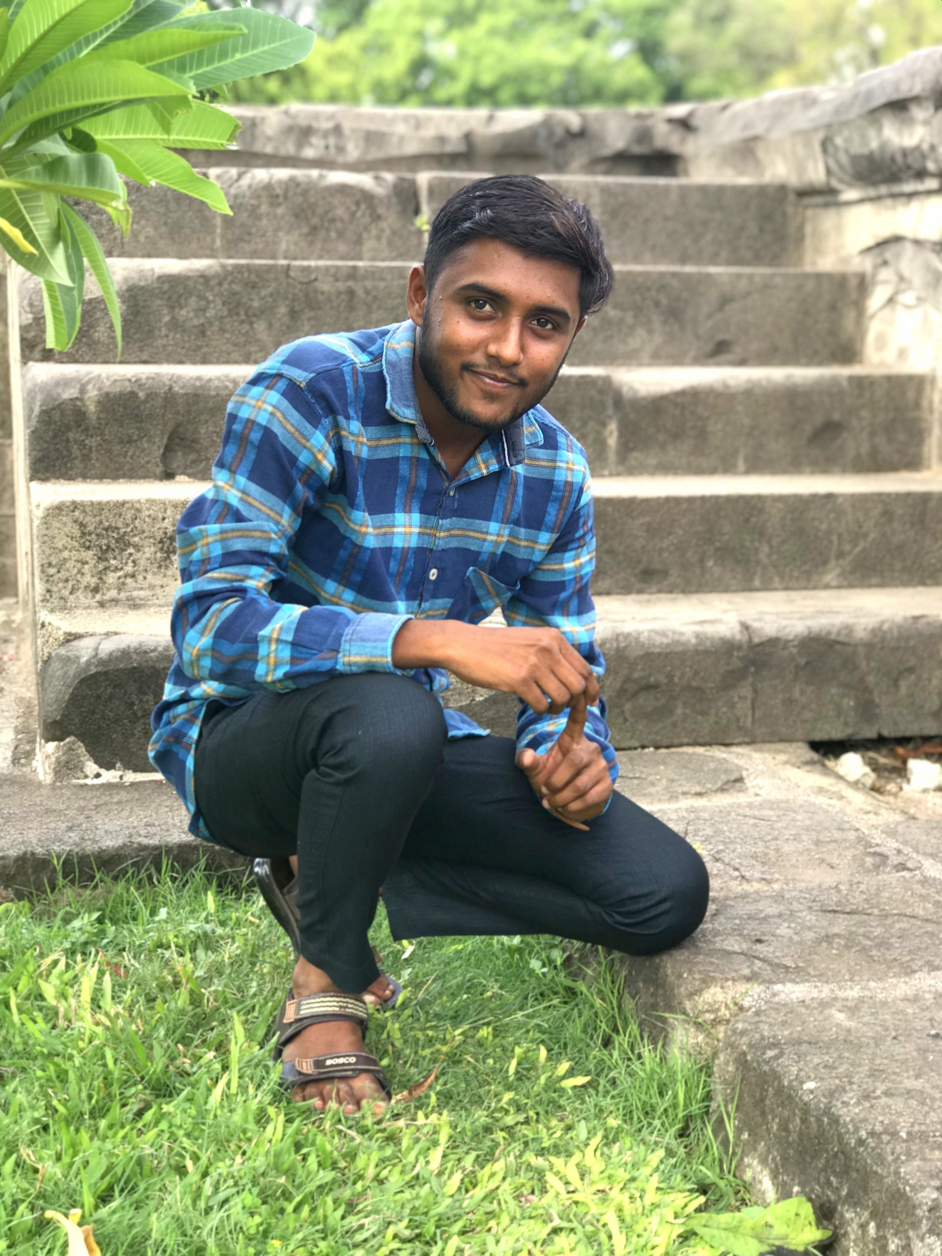 Boy posing in garden