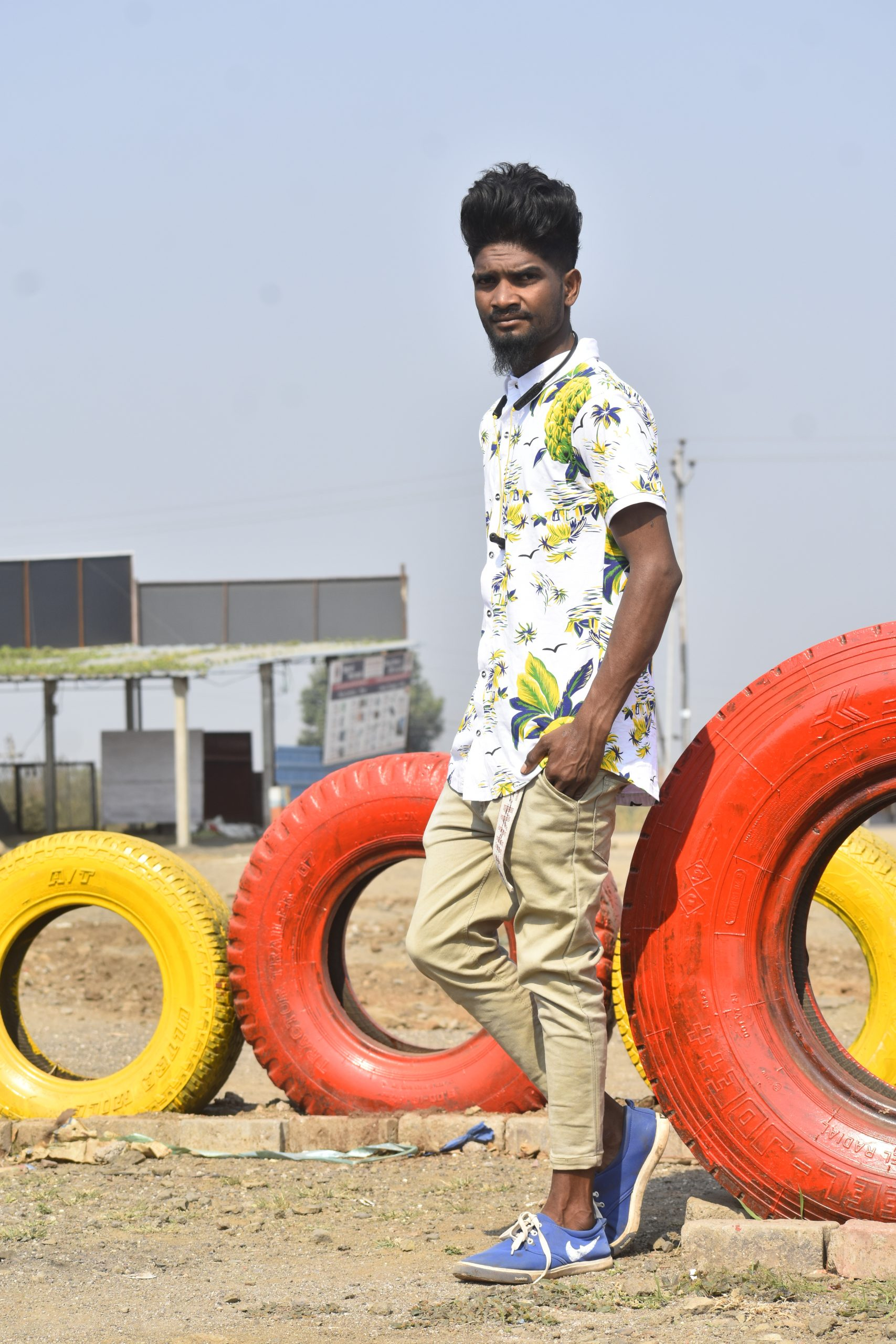 Boy posing near the tire