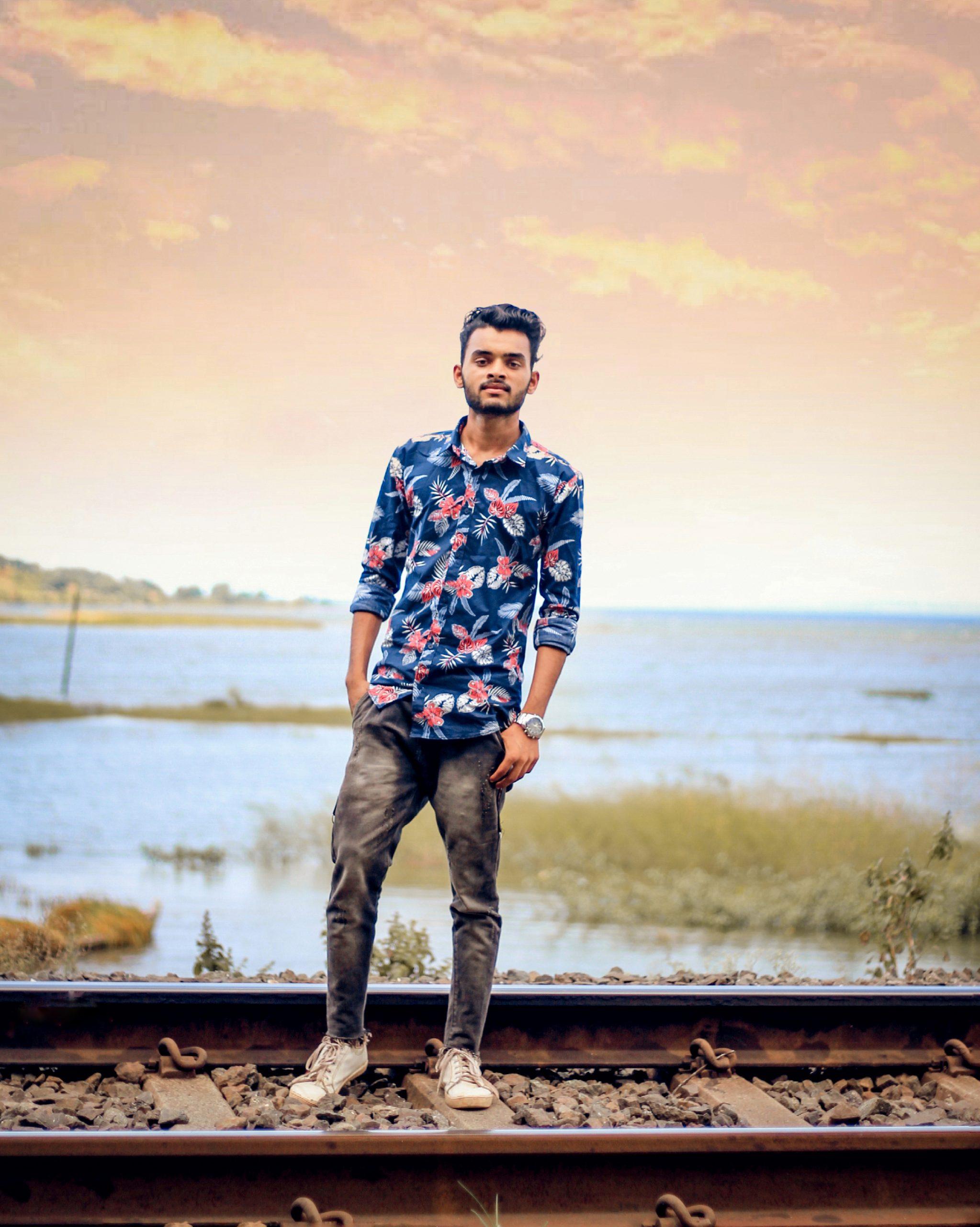 Boy posing on railway track