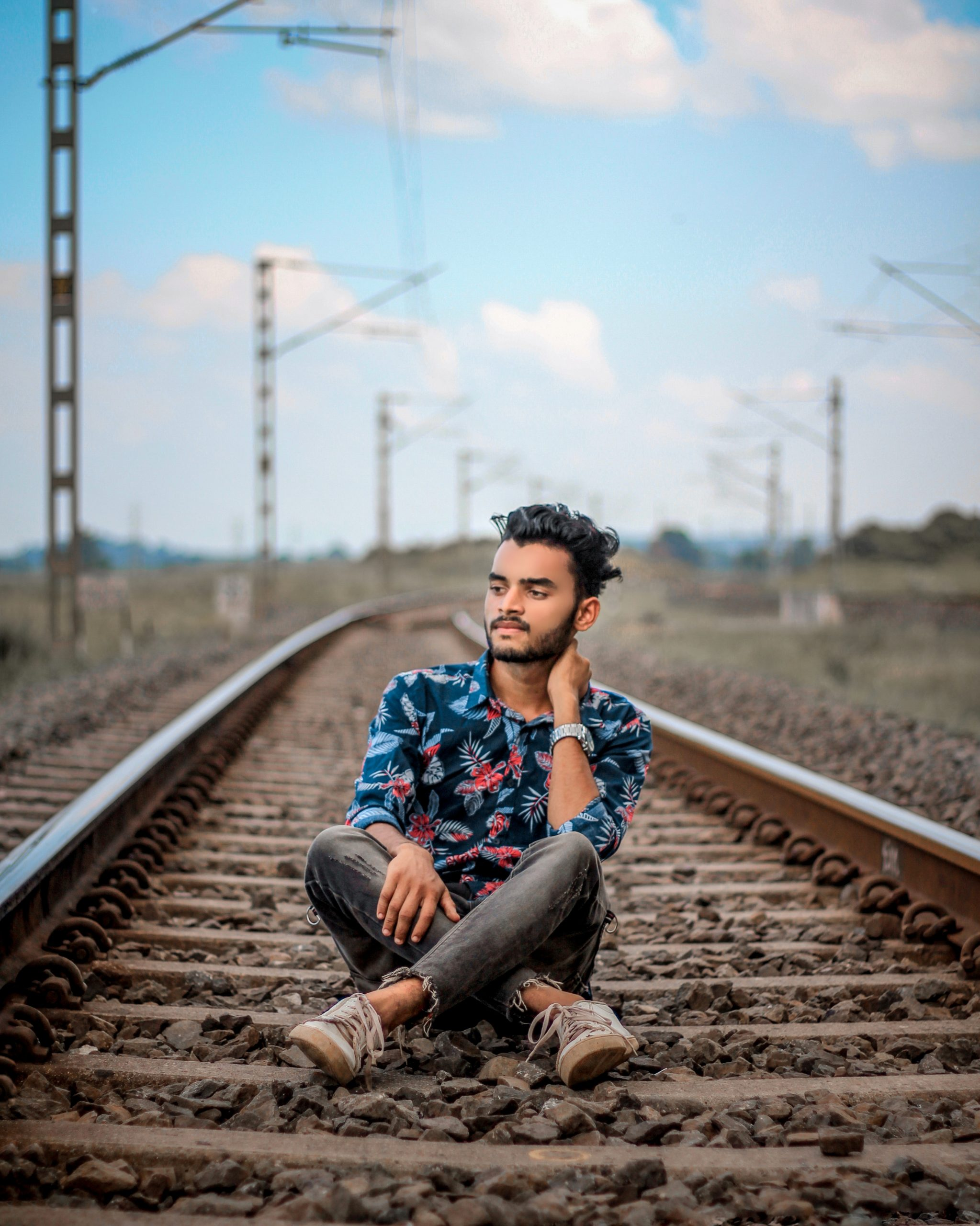 Boy posing on railway track