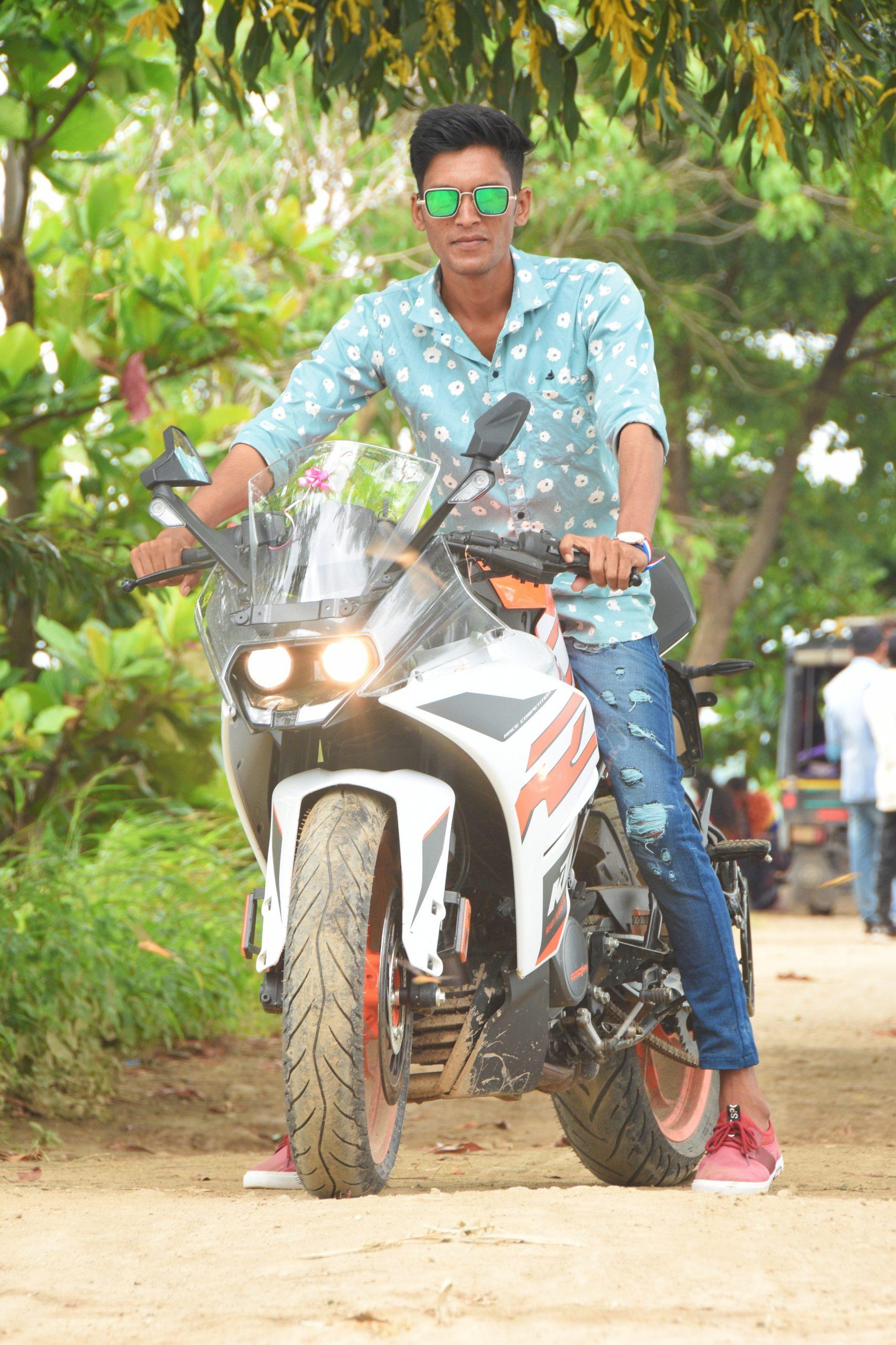 Boy riding KTM bike in forest