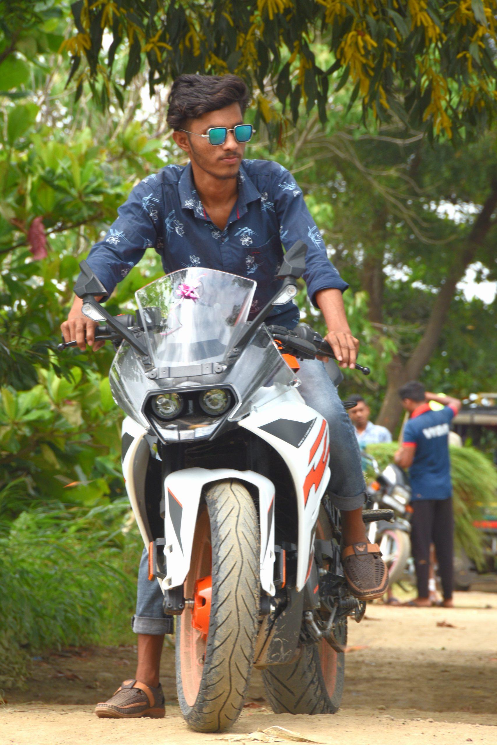Boy riding bike in garden