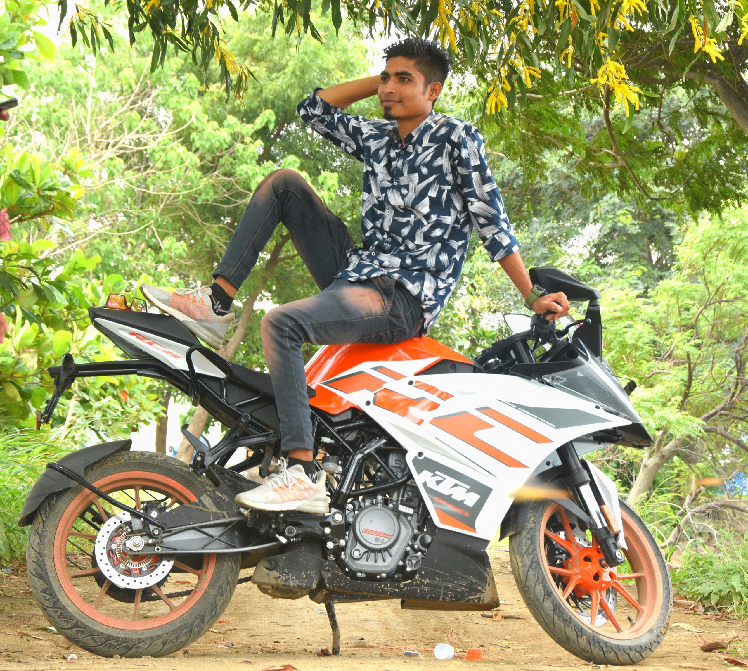 Boy sitting on KTM and posing