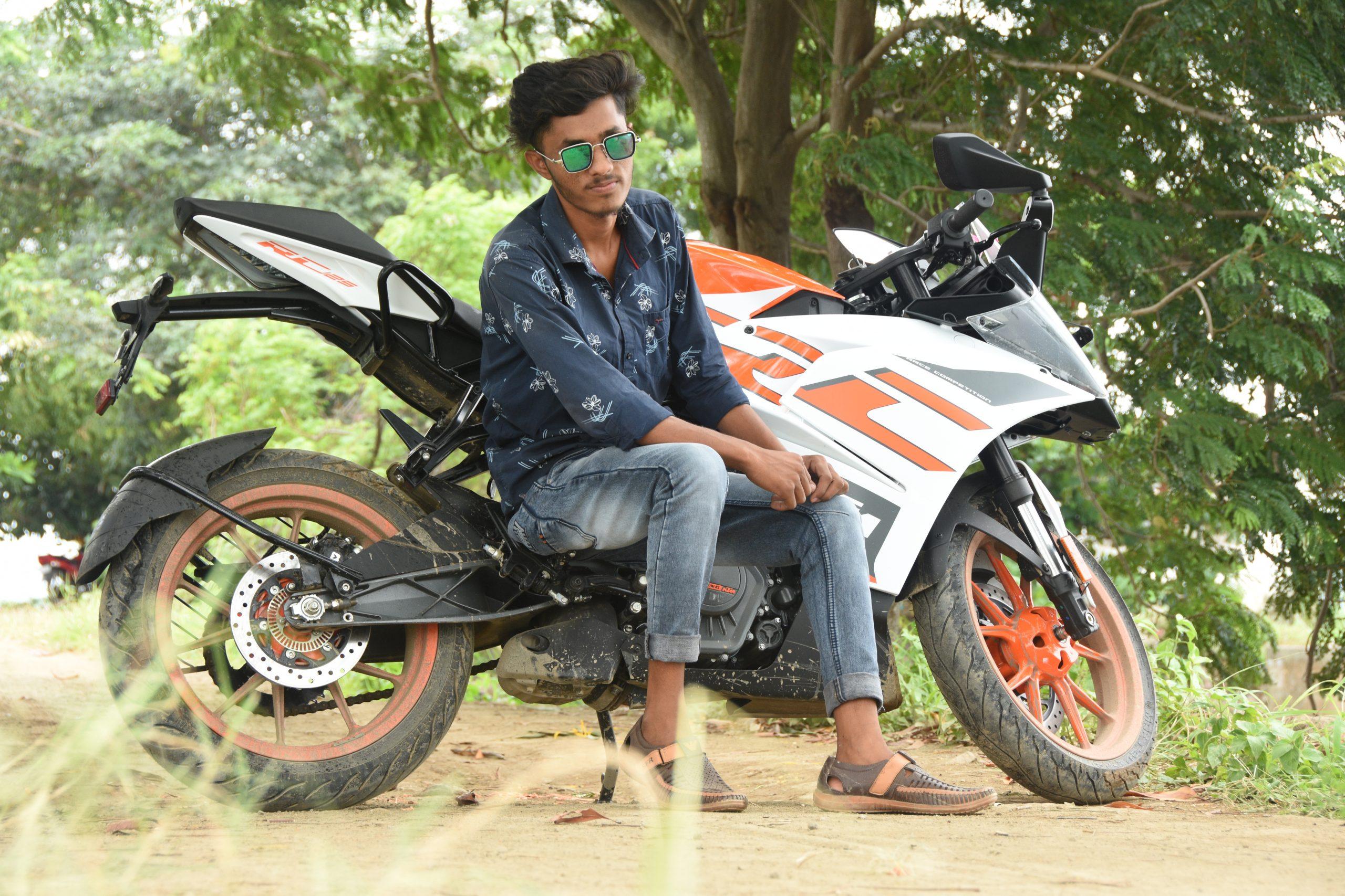 Boy sitting on KTM bike