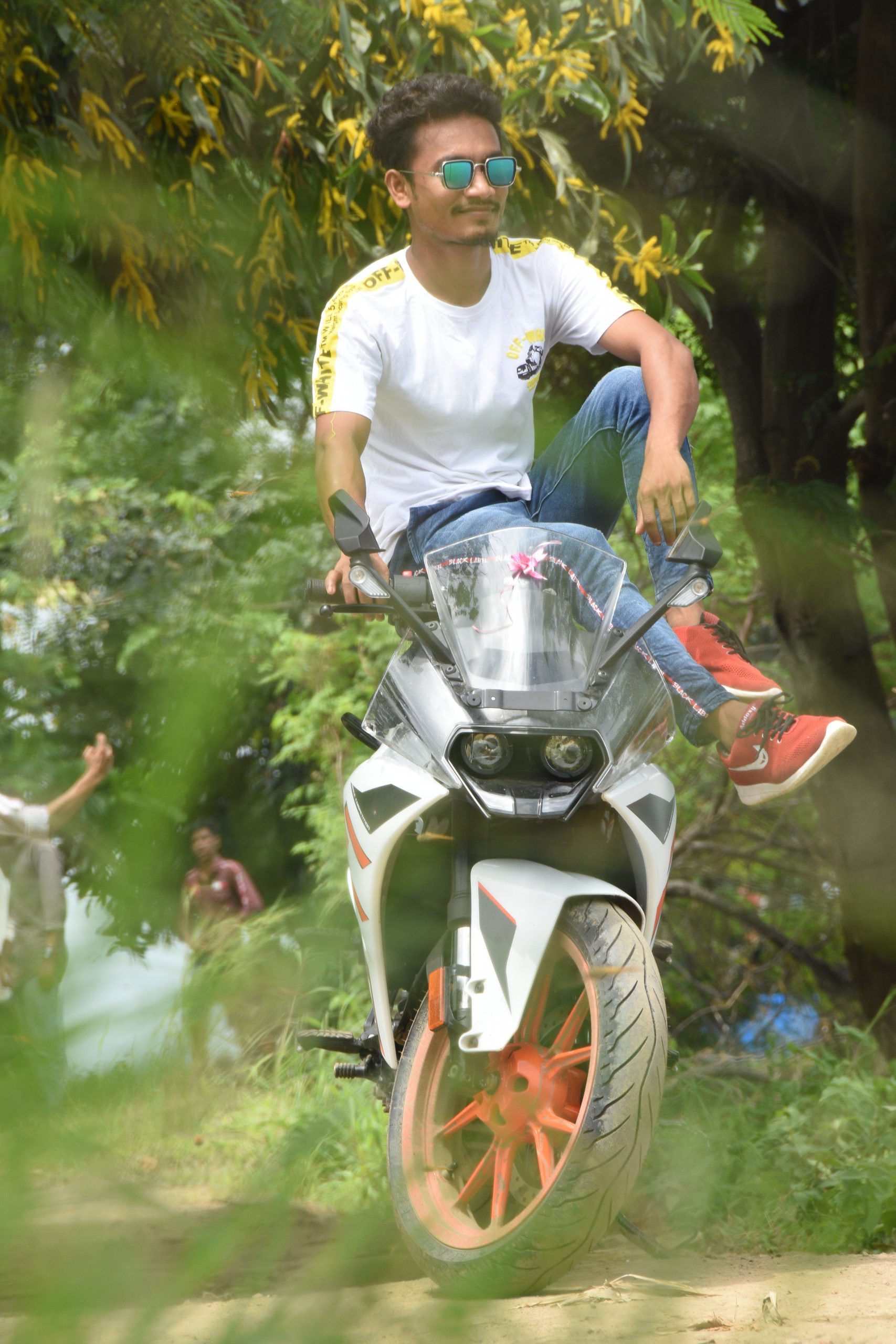 Boy sitting on KTM