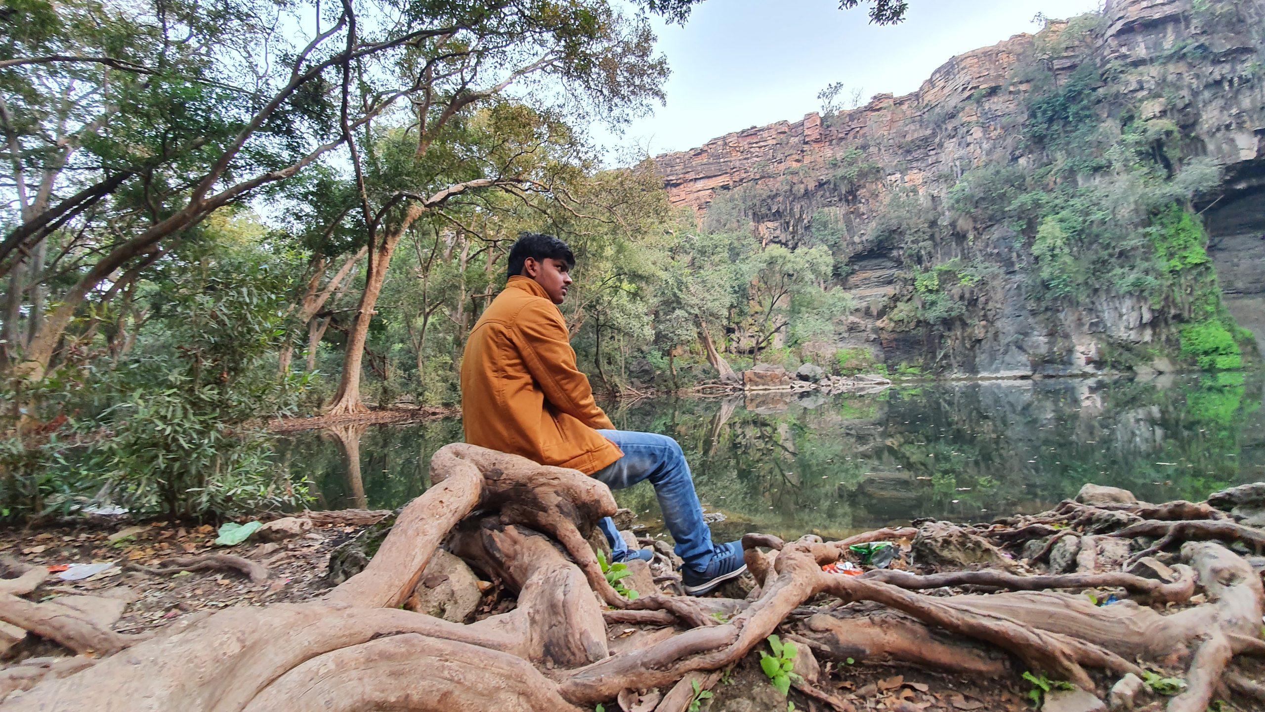 Boy sitting on logs