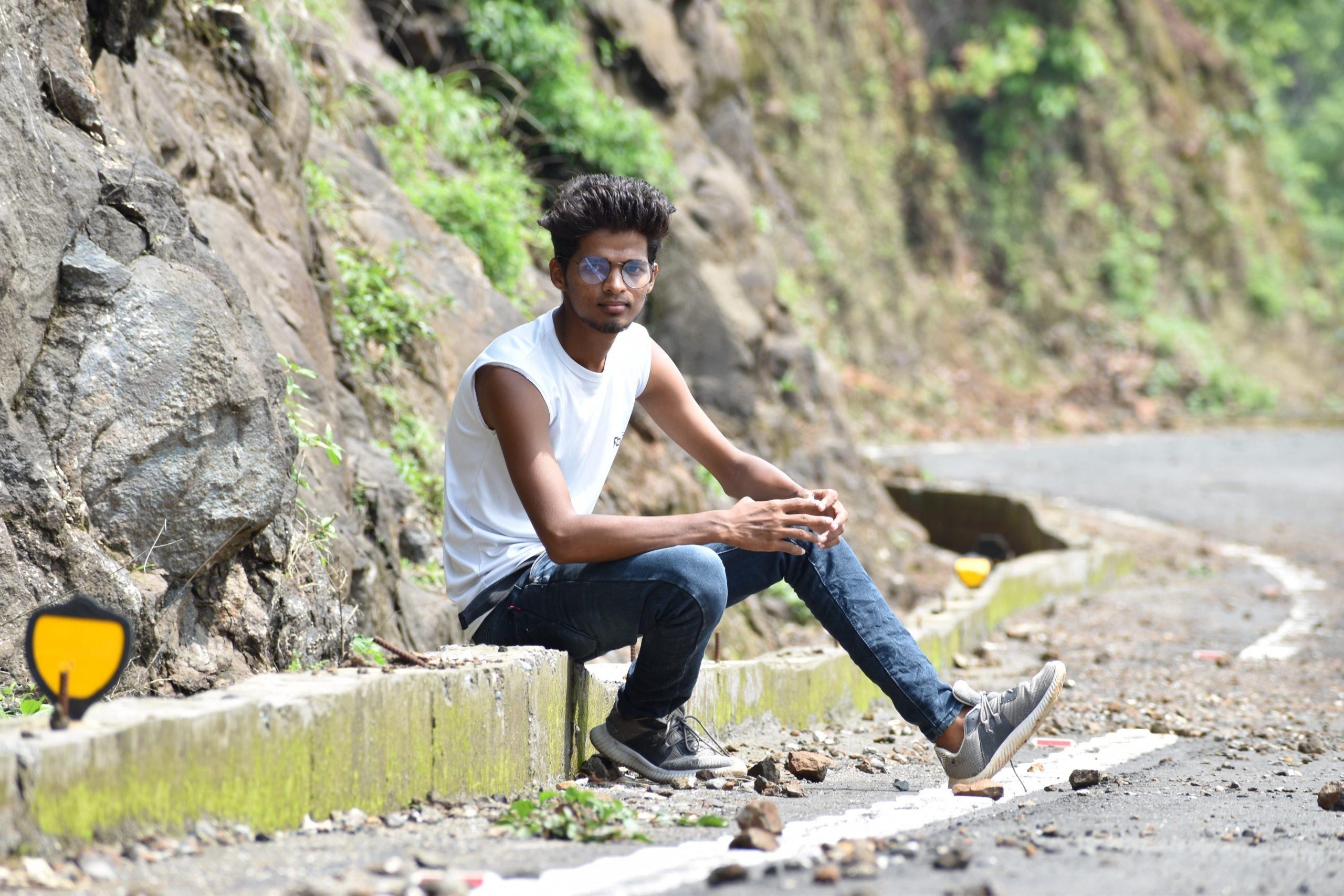 Boy sitting roadside