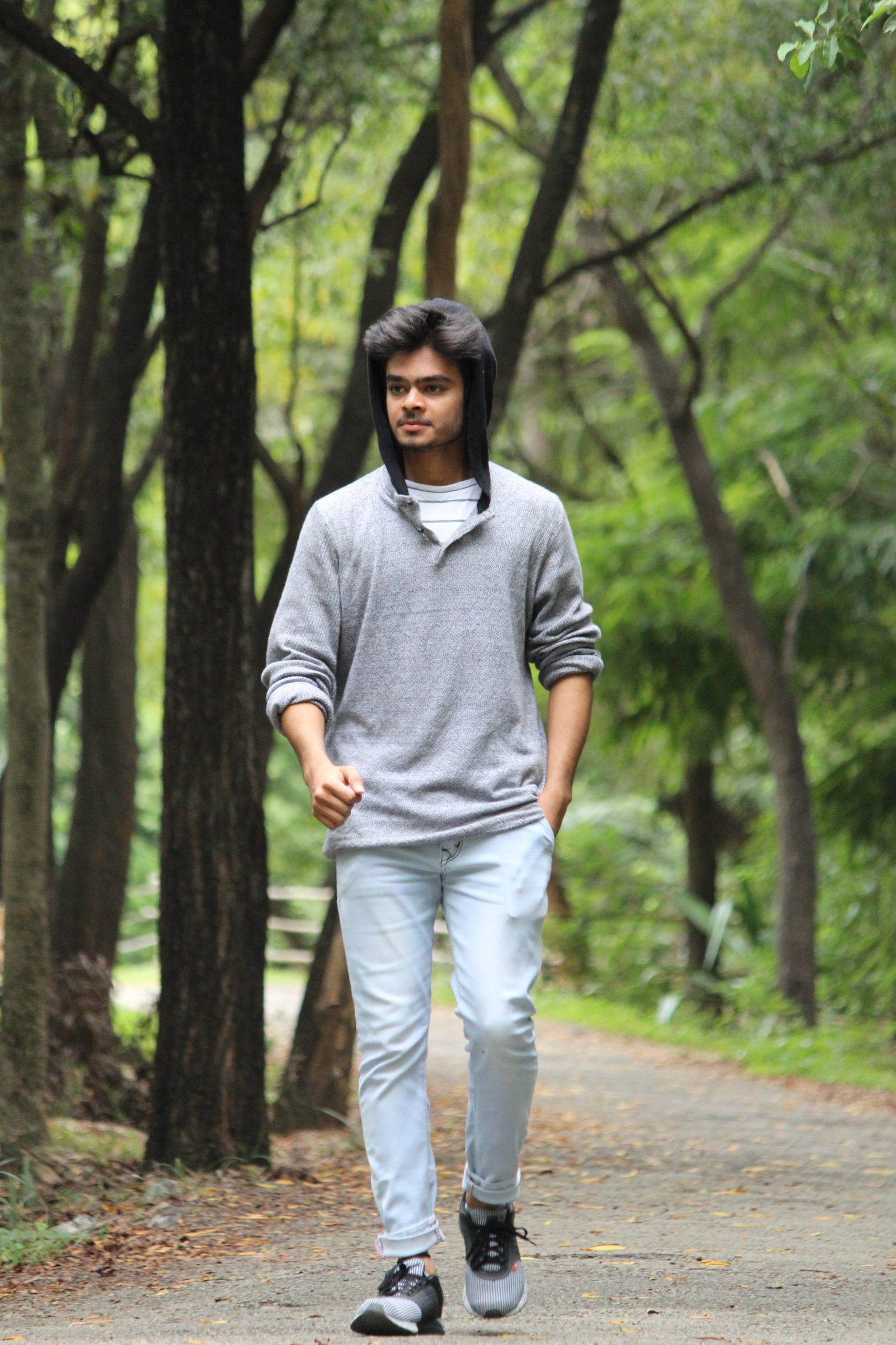Boy walking in the forest