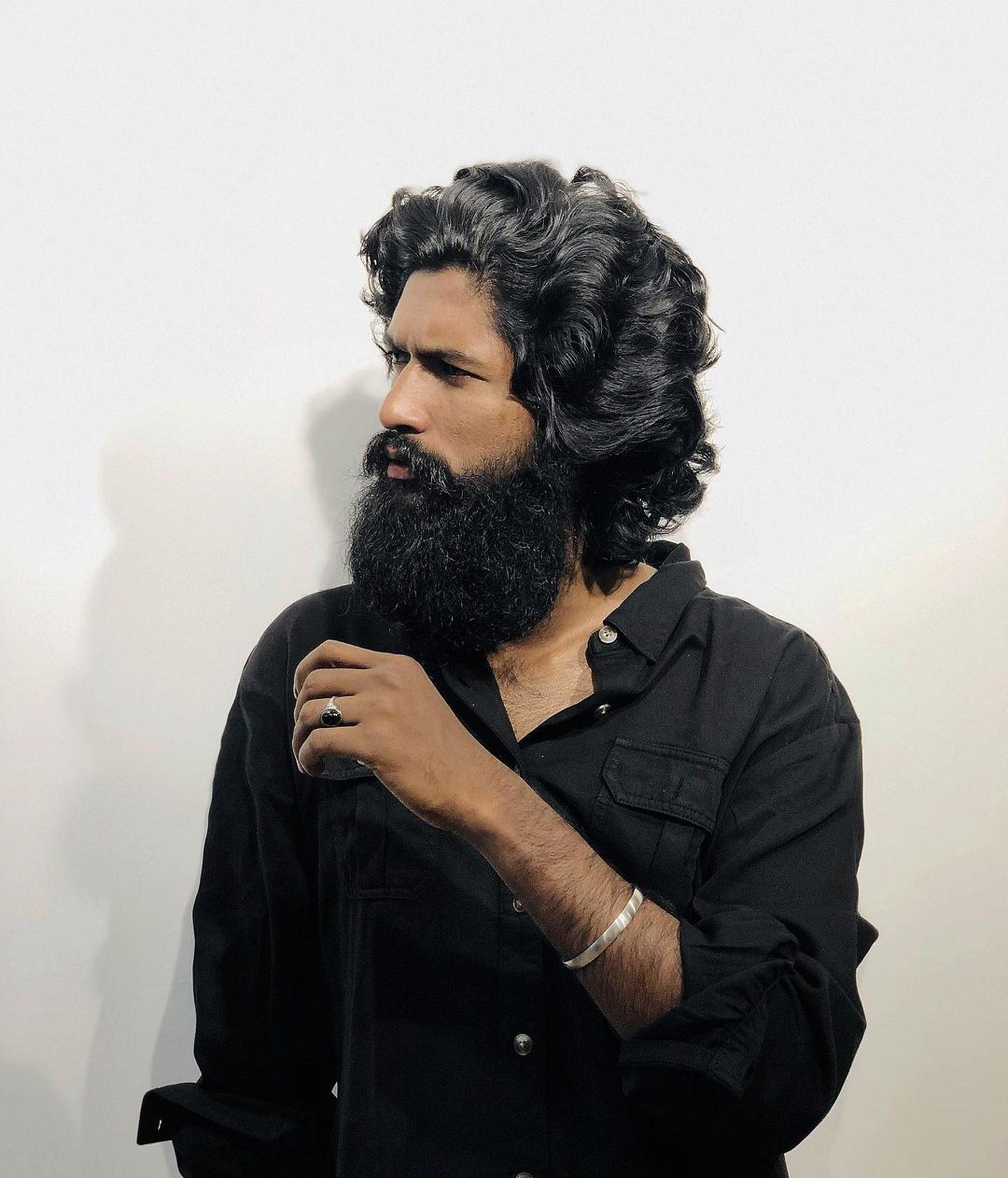 Boy with beard posing