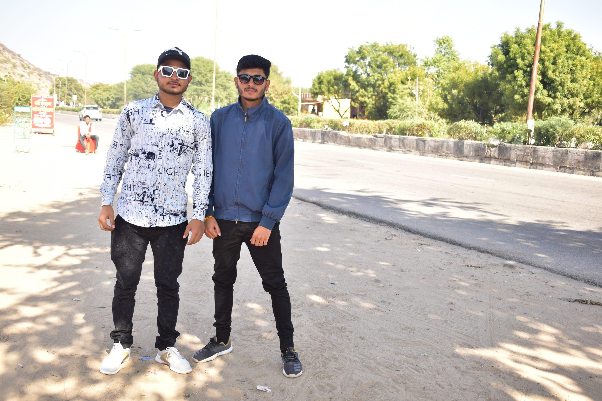Boys posing on road