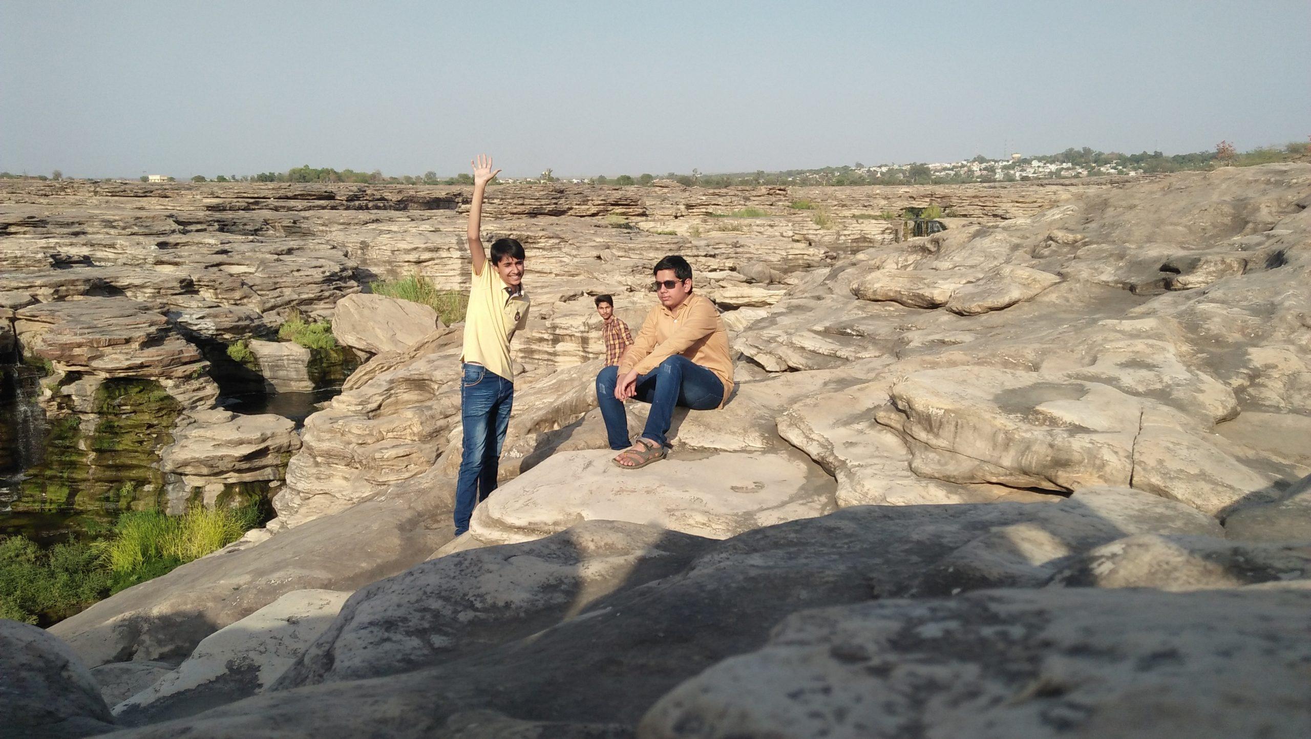 Boys near Chulliya falls rocks in Rajasthan