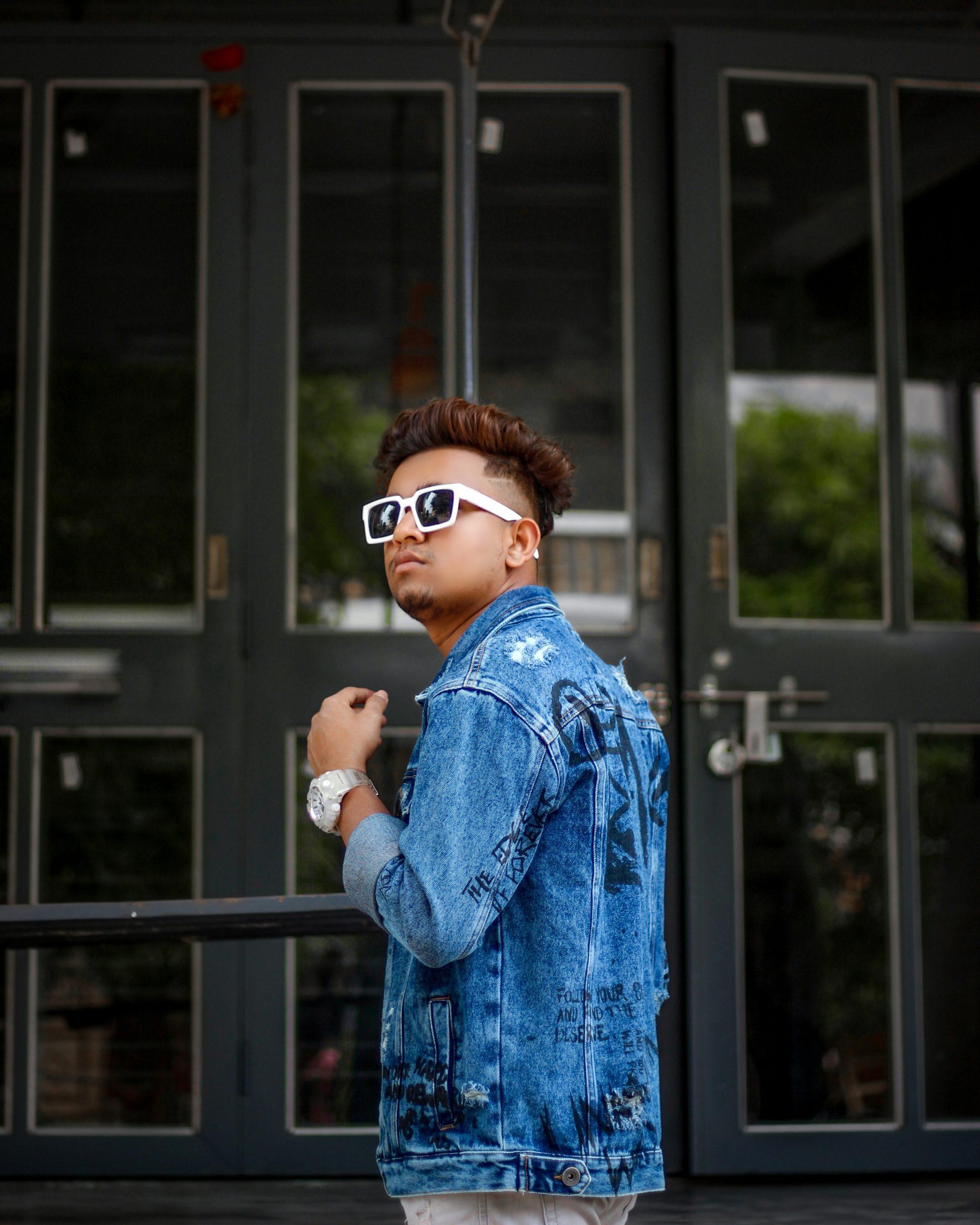 Boy posing in front of door