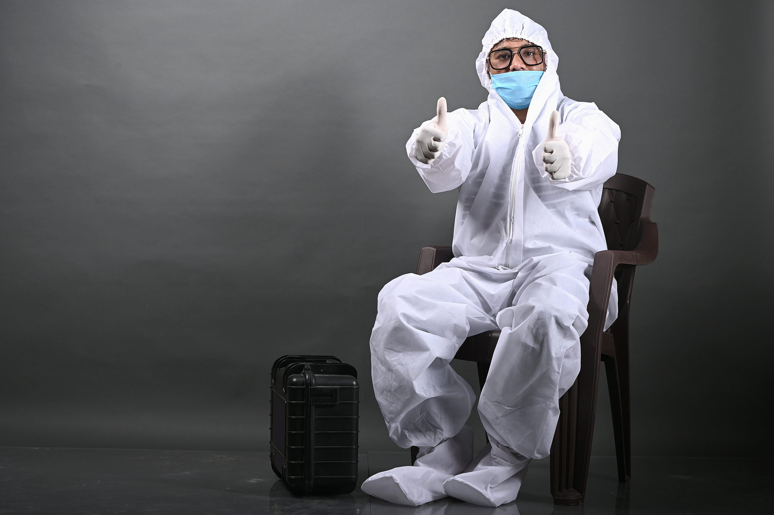 Doctor gesturing while wearing PPE kit