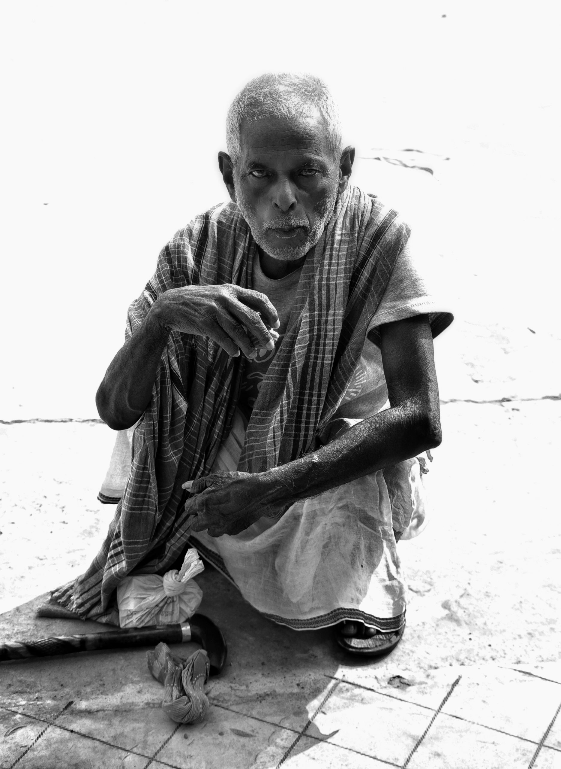Old man sitting and eating food
