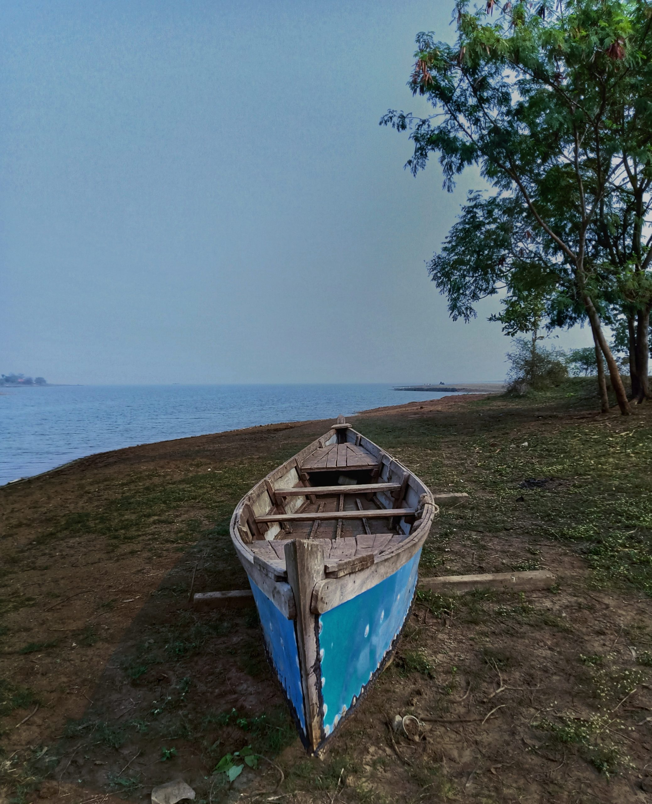 Boat lying at the side of the beach