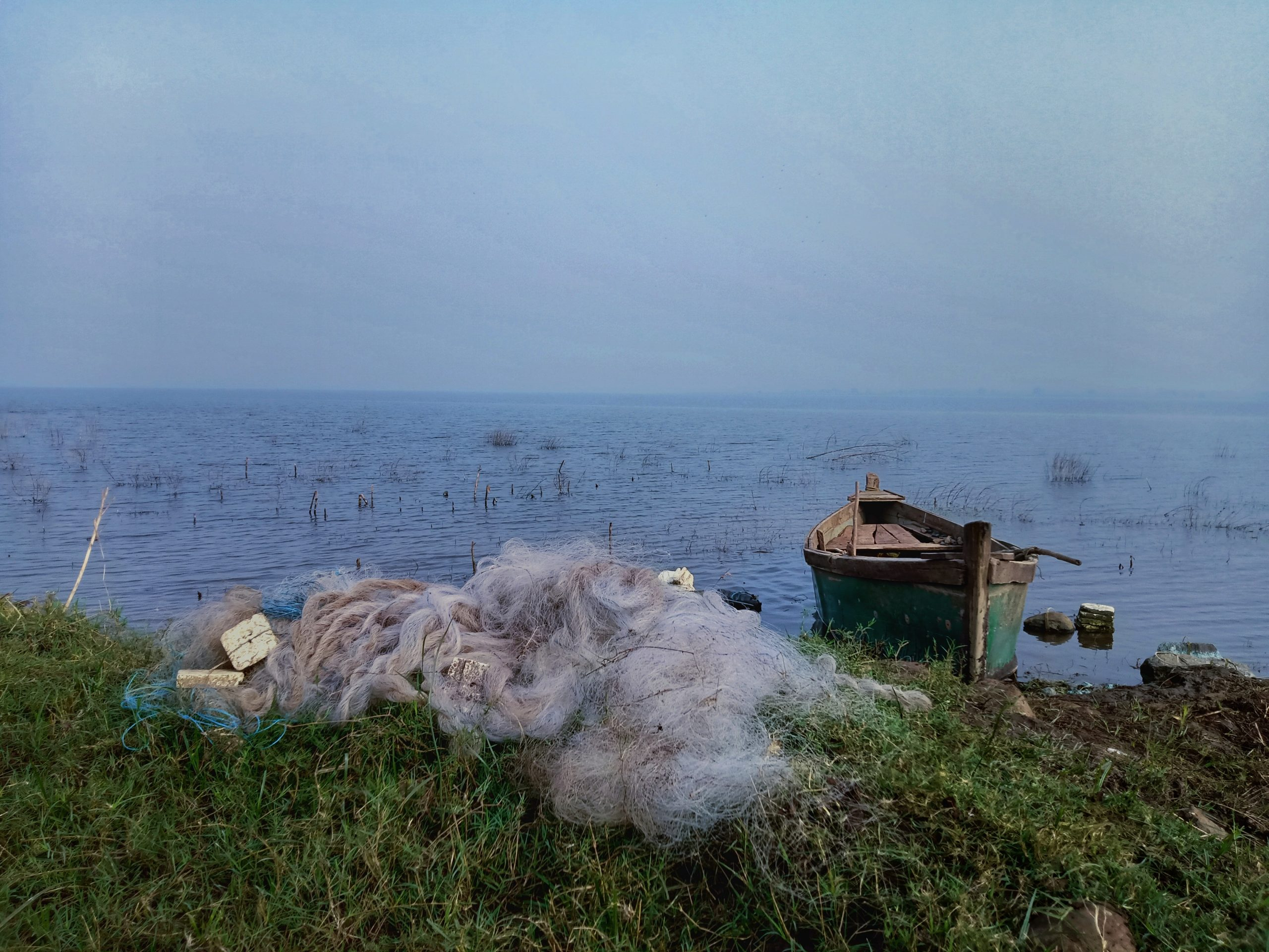 Fishing net and boat near the river