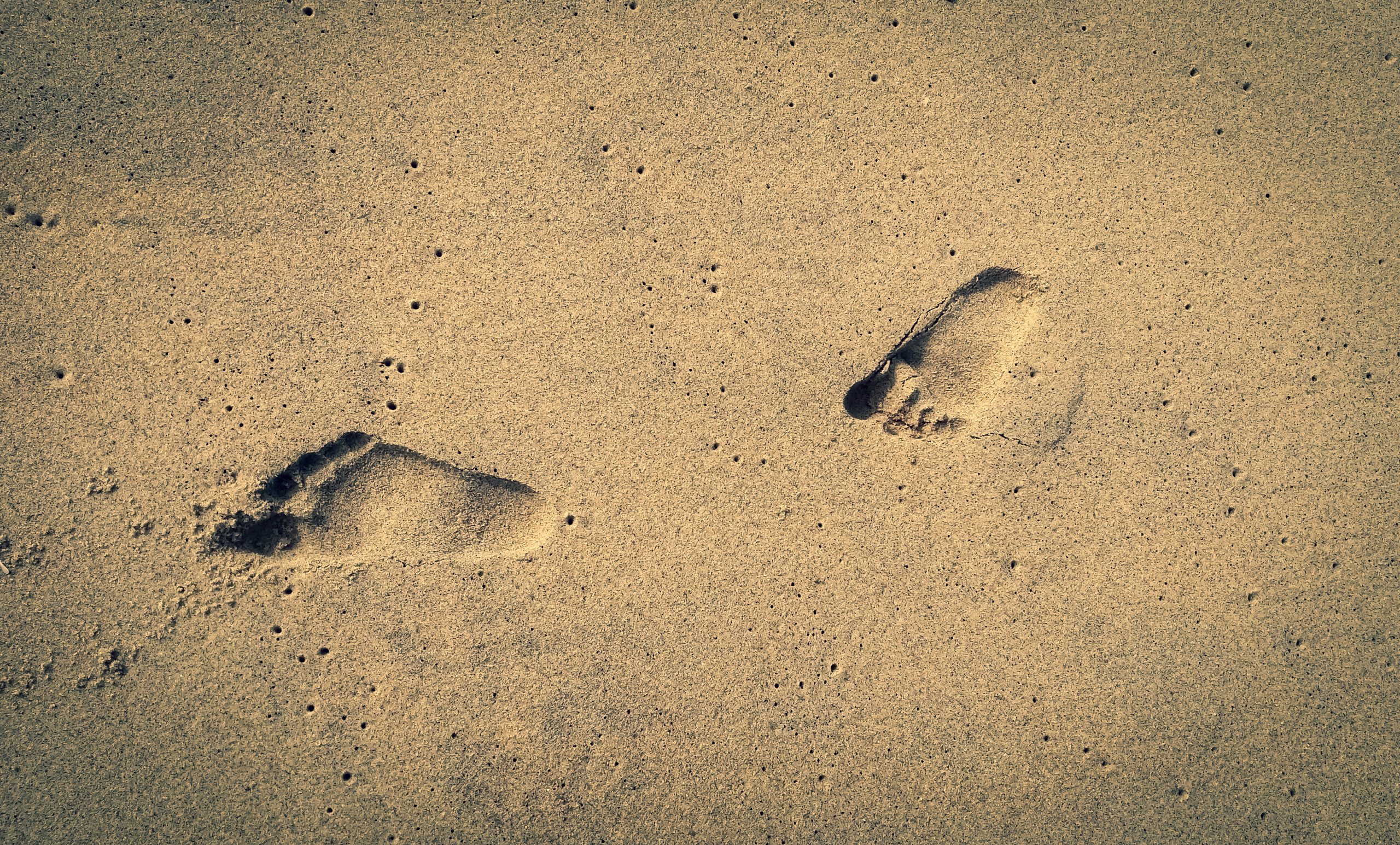 Foot marks on a beach