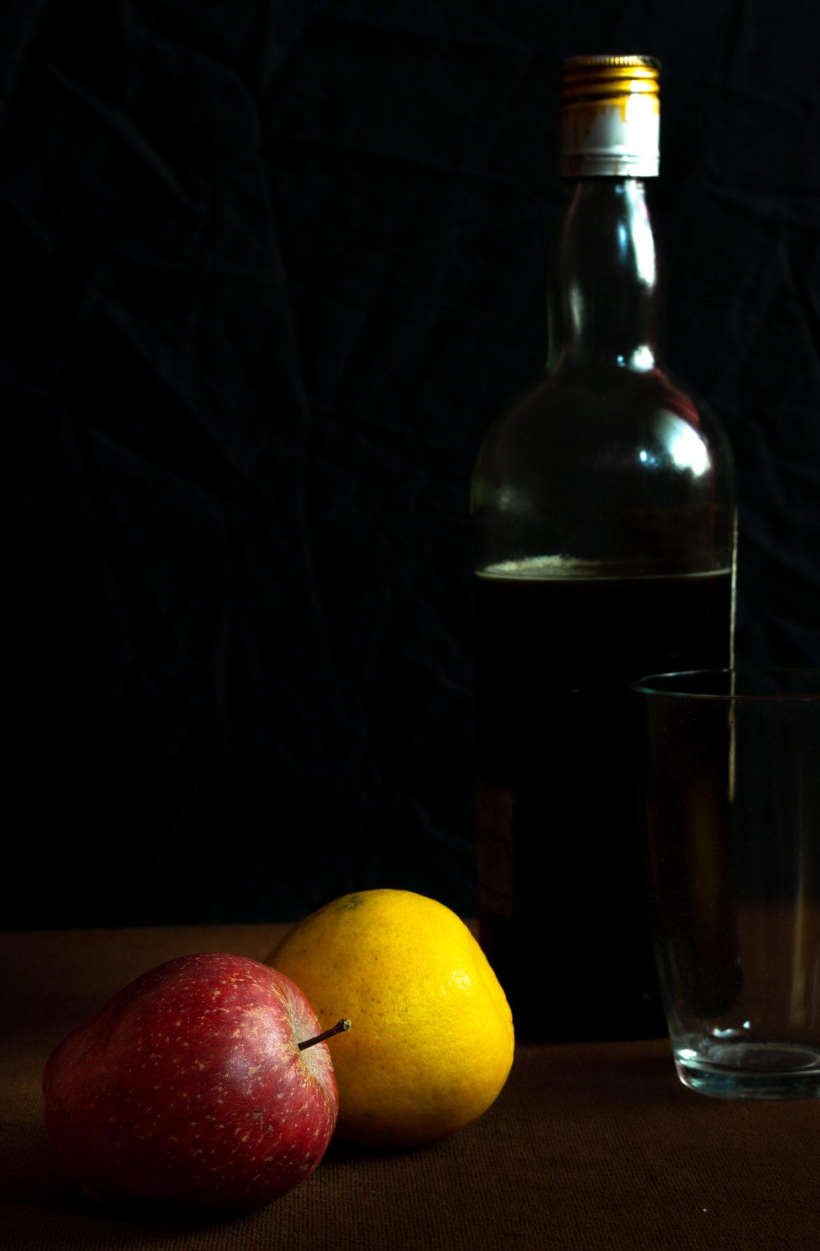 Fresh fruit and glass bottle