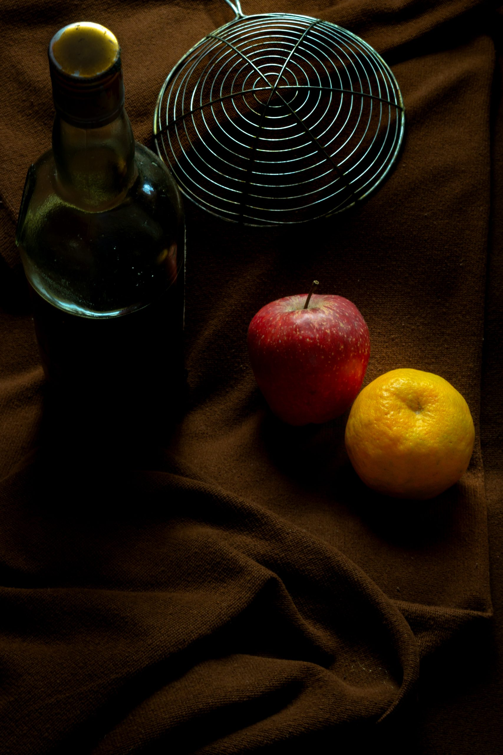 Fruits with bottle on bed