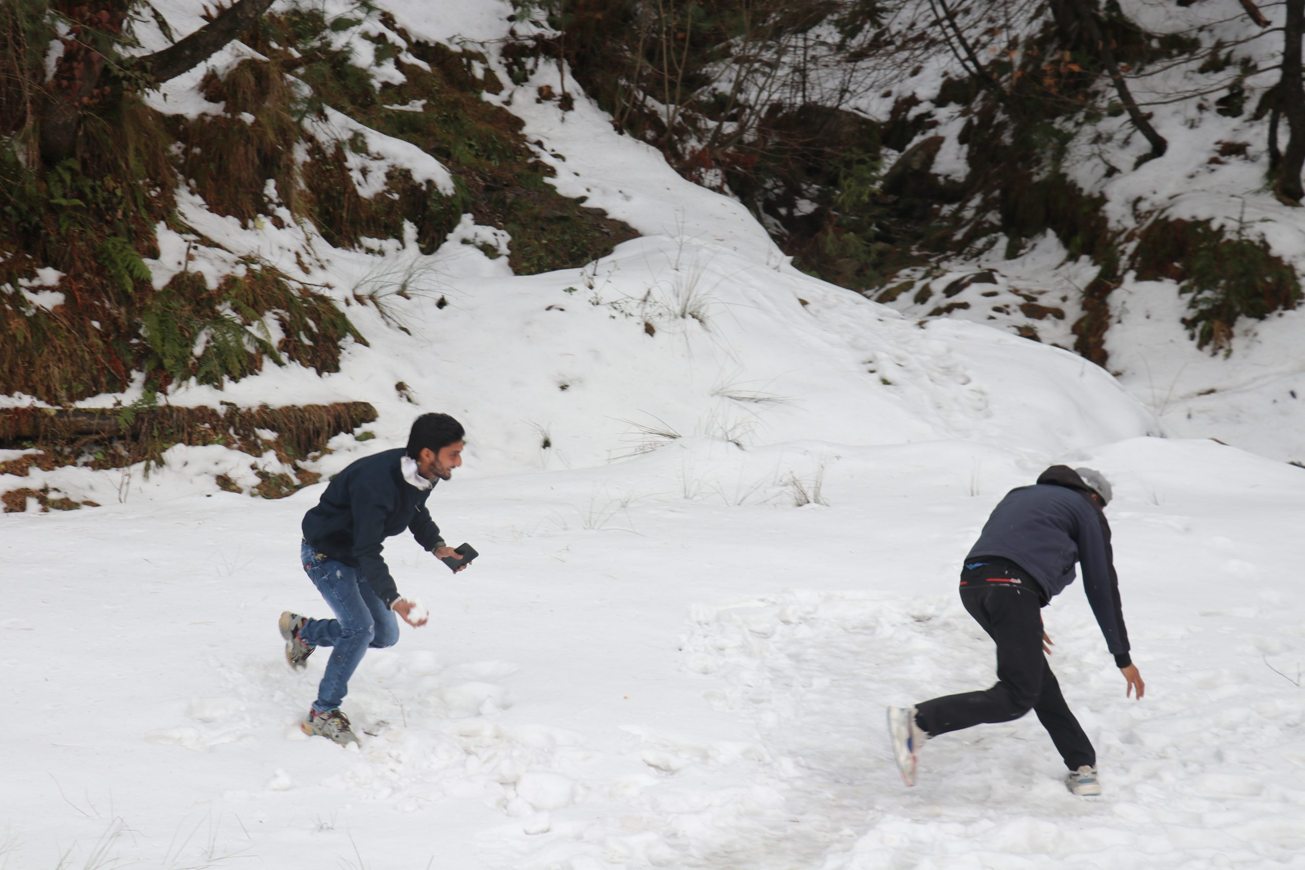 Boys playing with snow