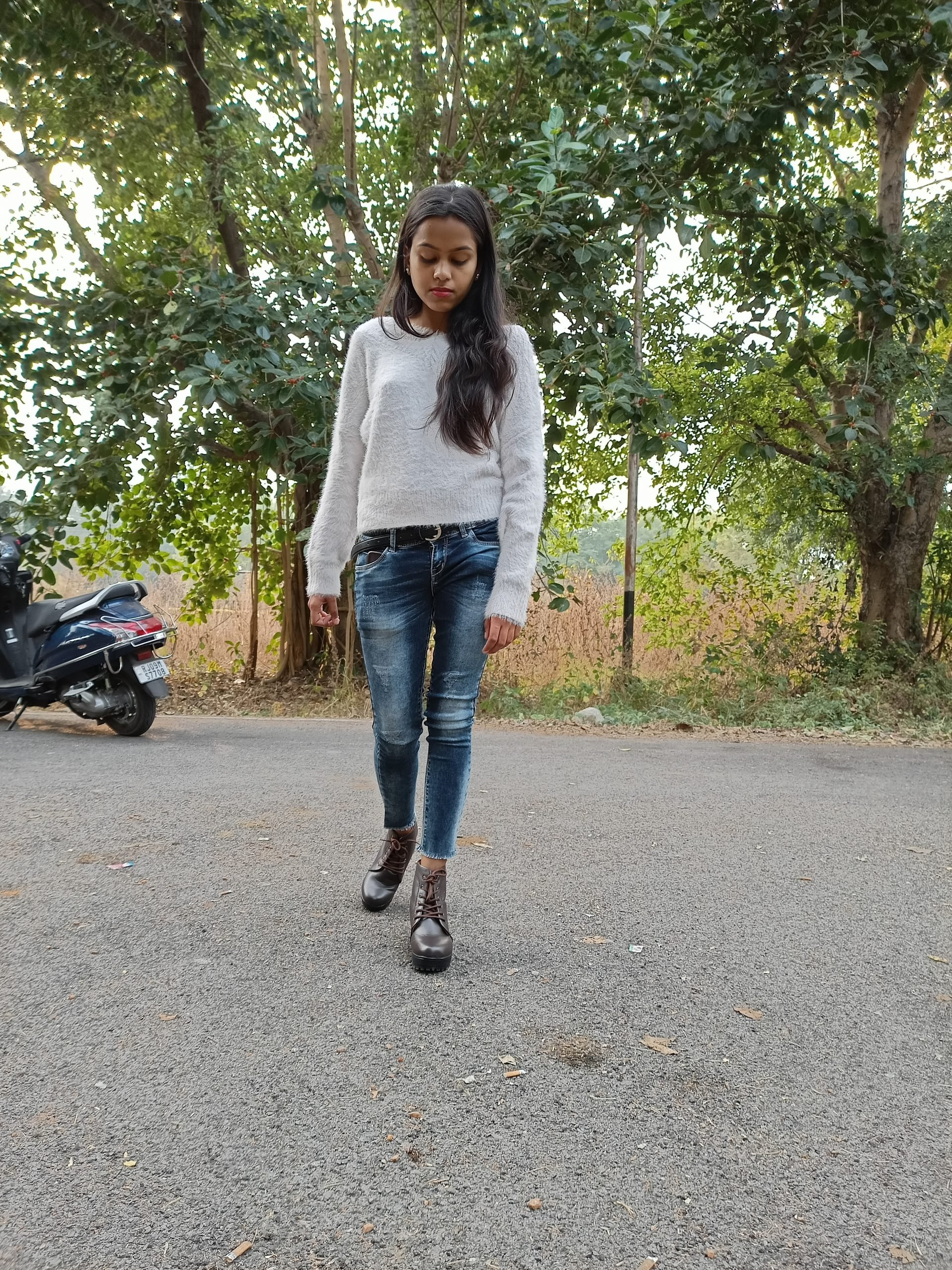 Girl posing on road