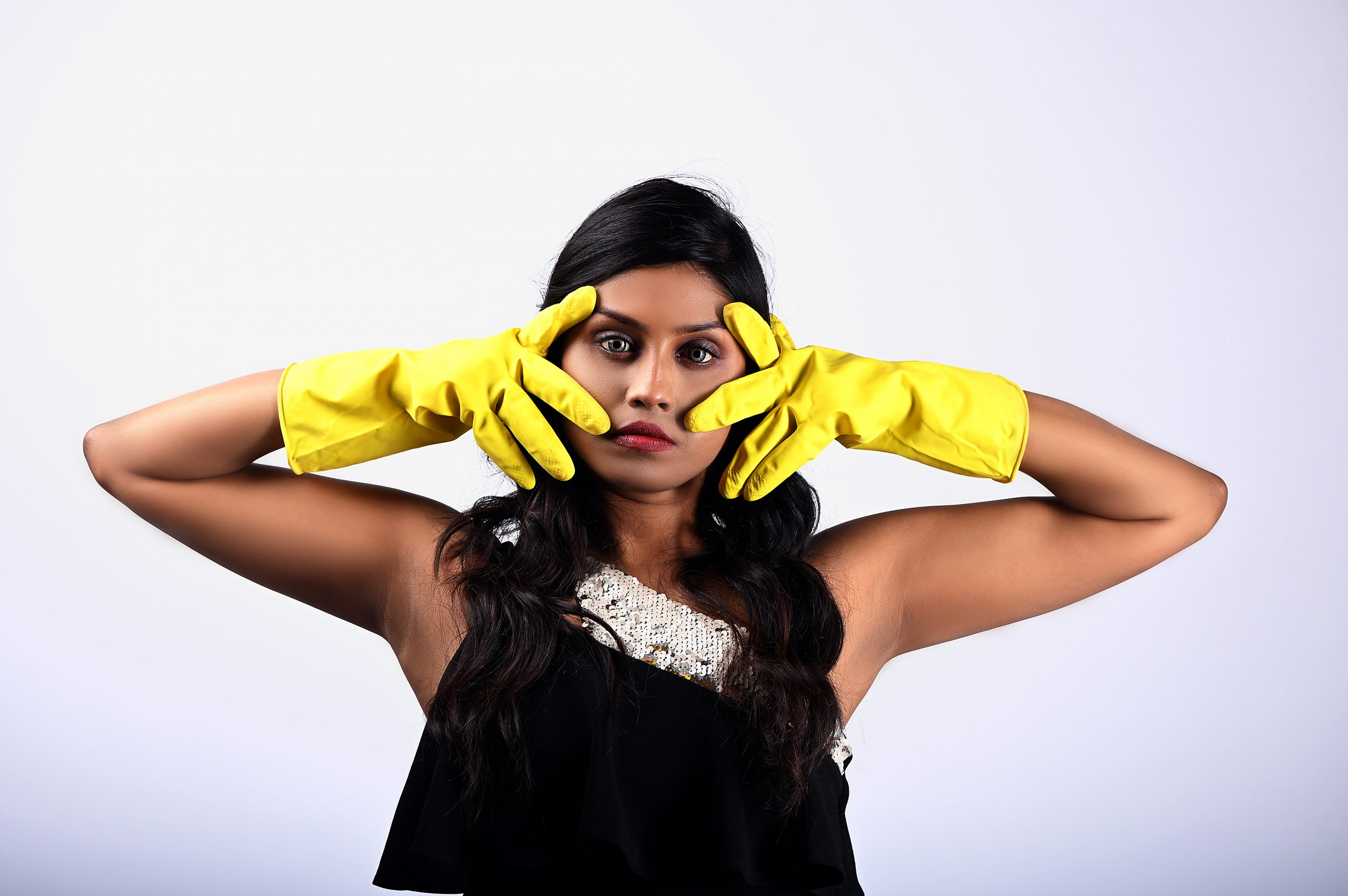 Girl posing while wearing hand gloves