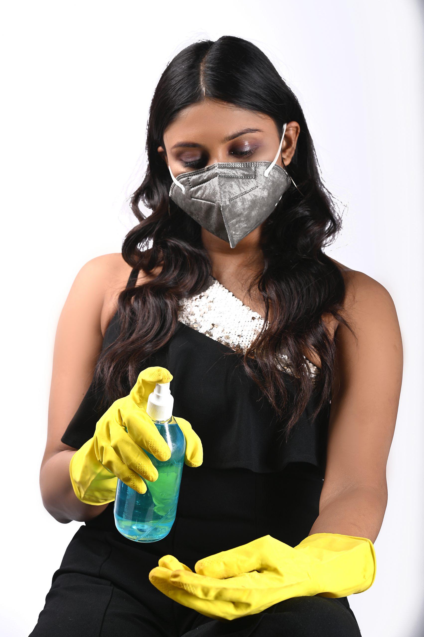 Girl sanitizing her hand