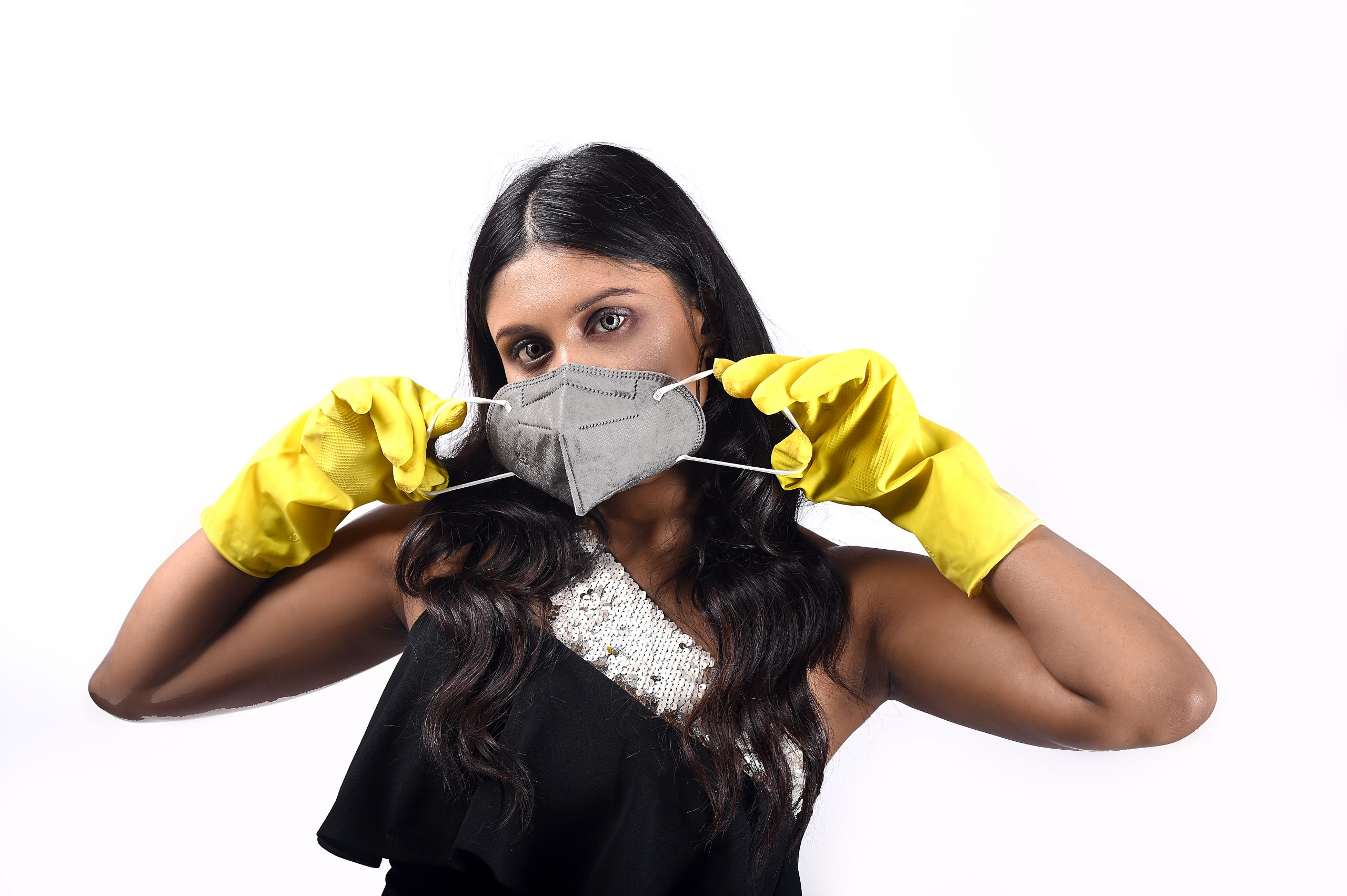Girl wearing facemask and hand gloves