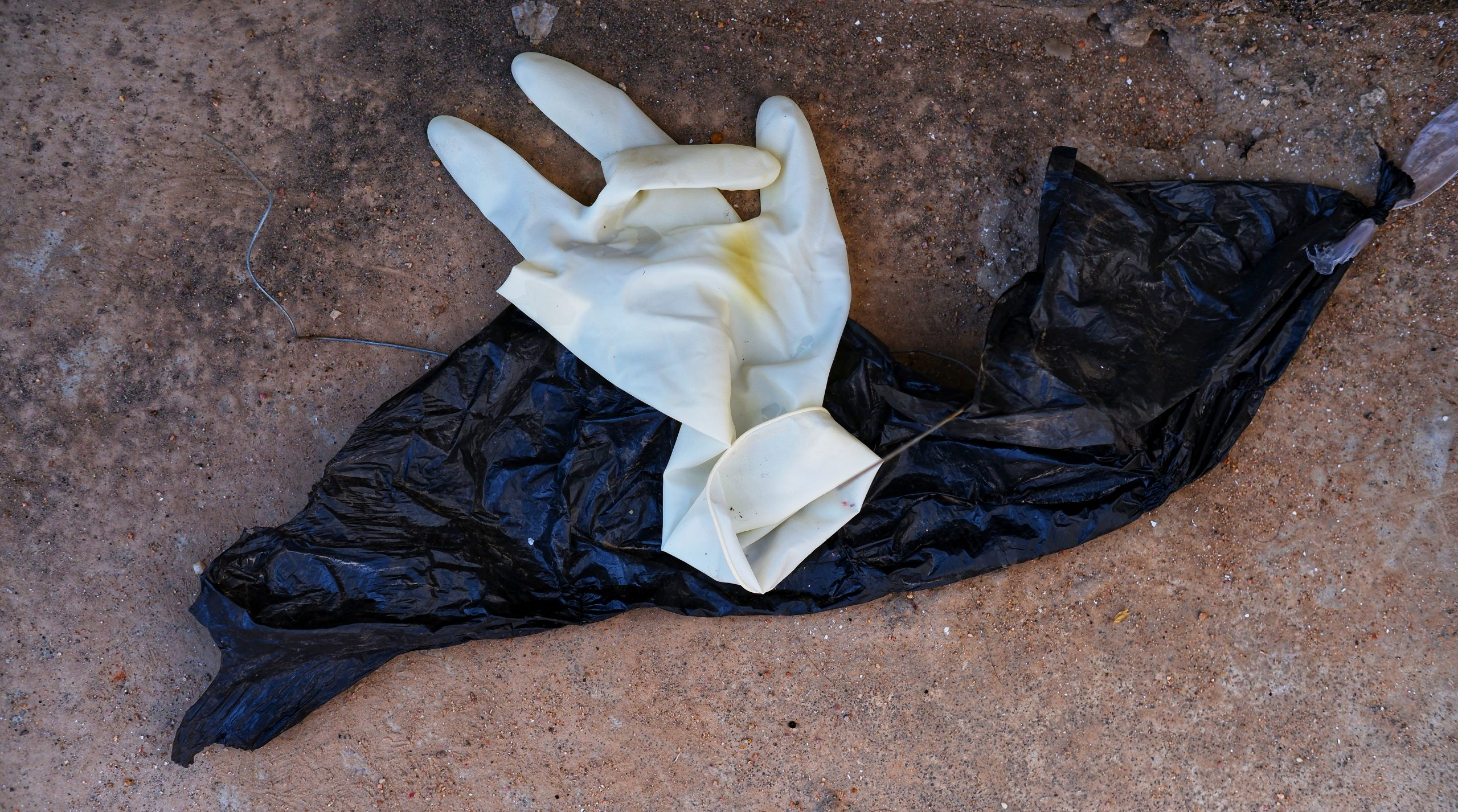 Hand gloves laying on floor