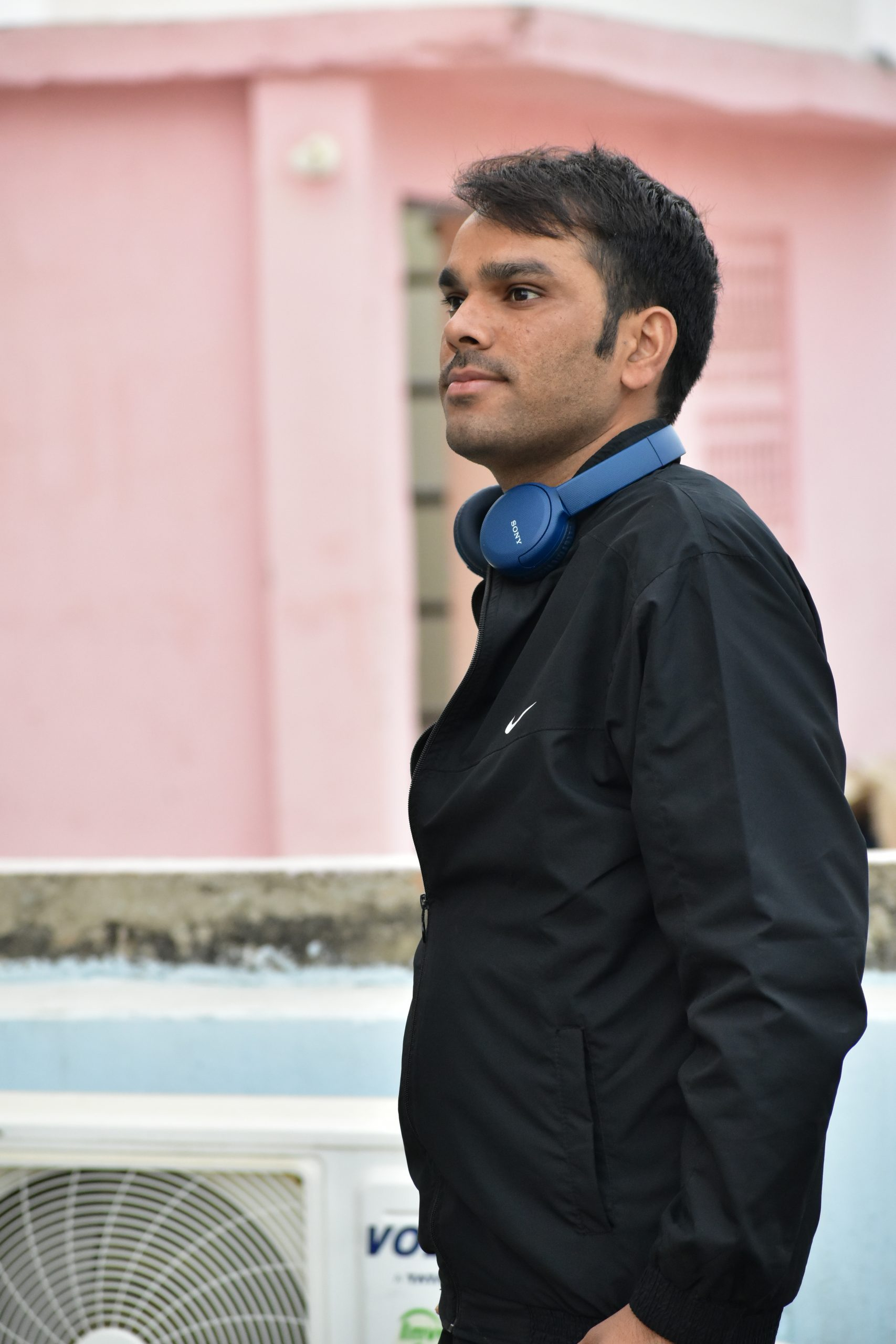 Man giving pose with headphone