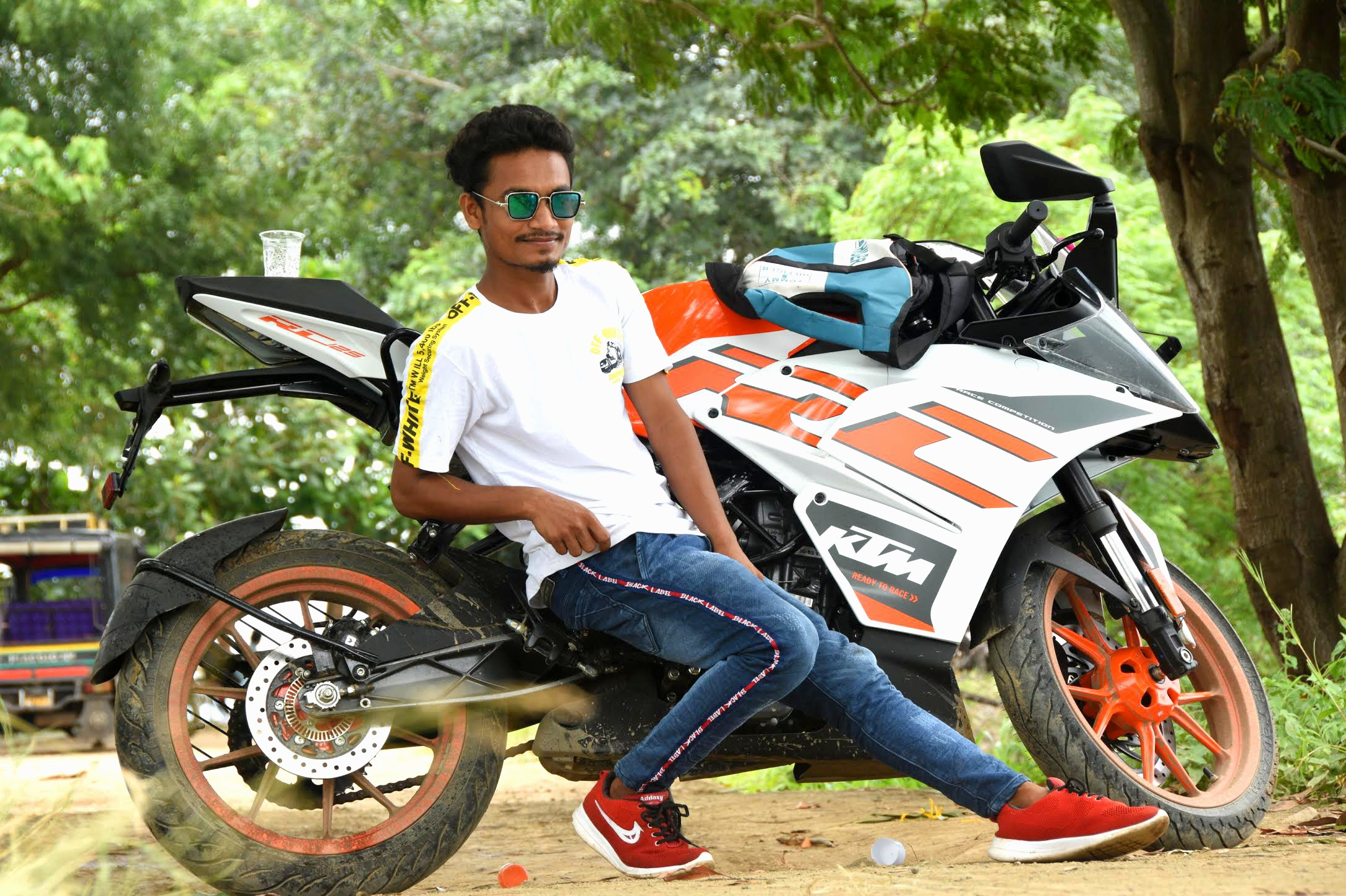 Boy posing with KTM bike