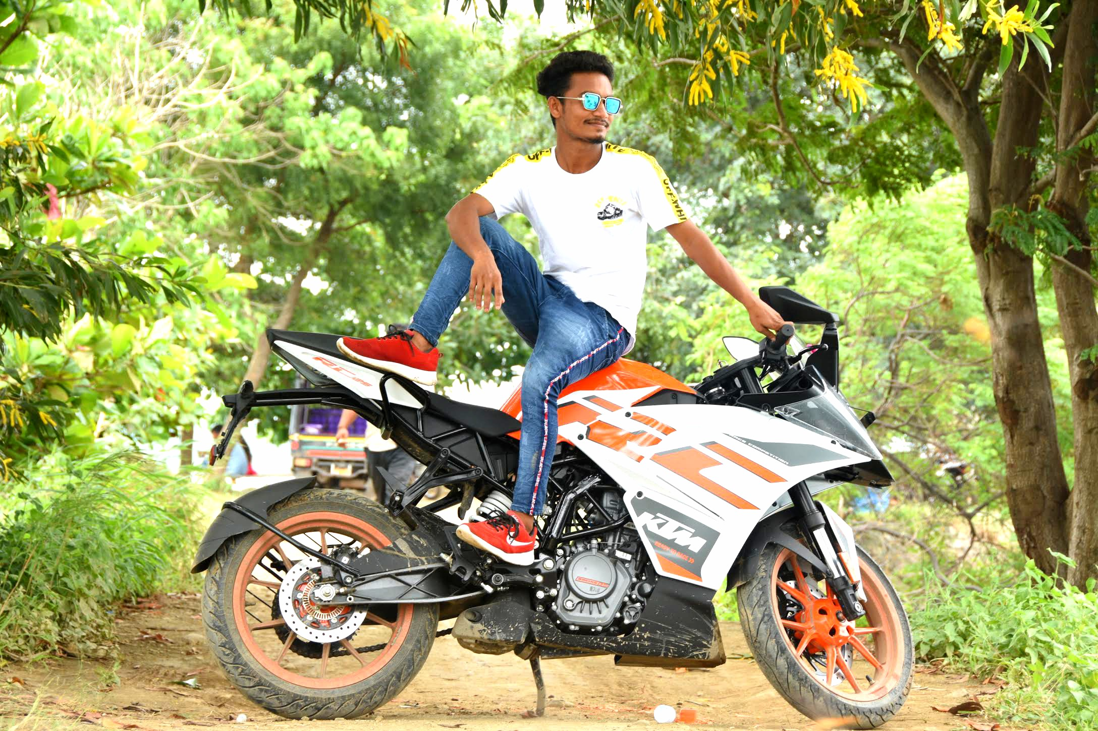 Boy posing on KTM bike