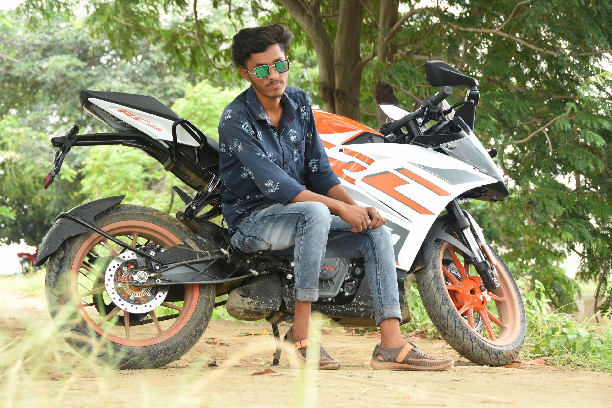 Boy posing on bike