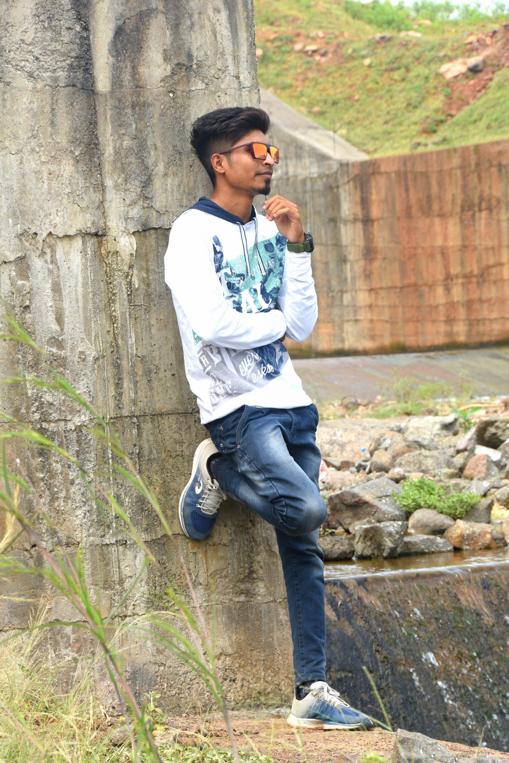 boy posing beside the wall