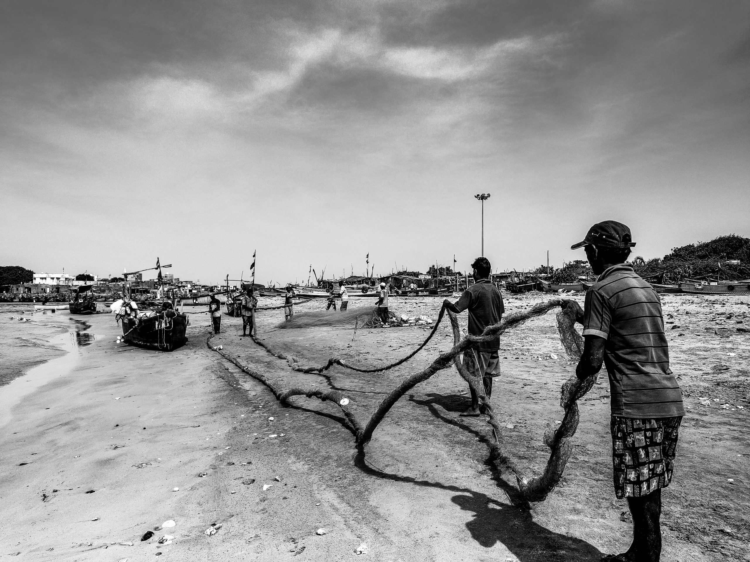 Fishermen on a beach