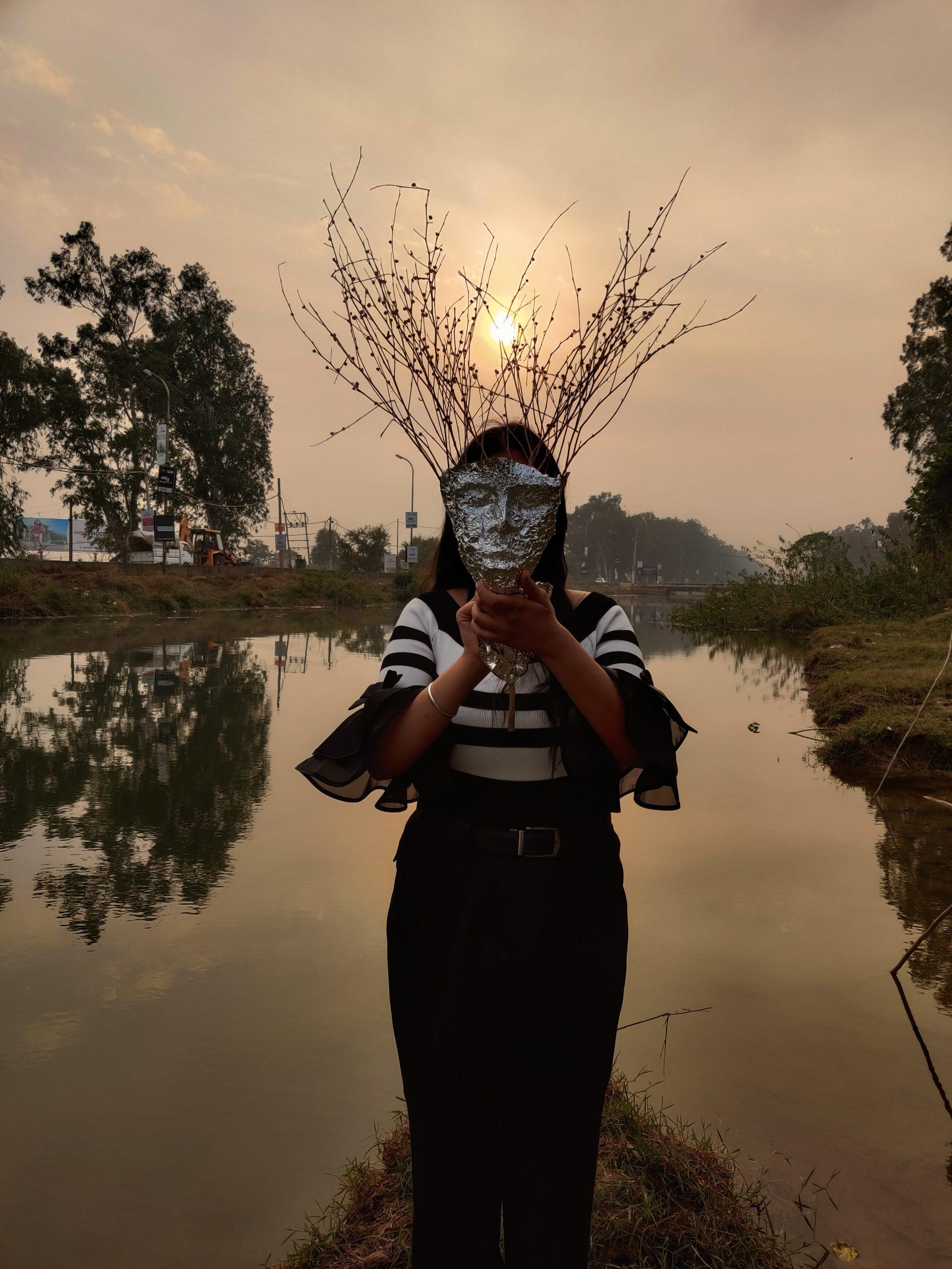 A girl in vampire mask