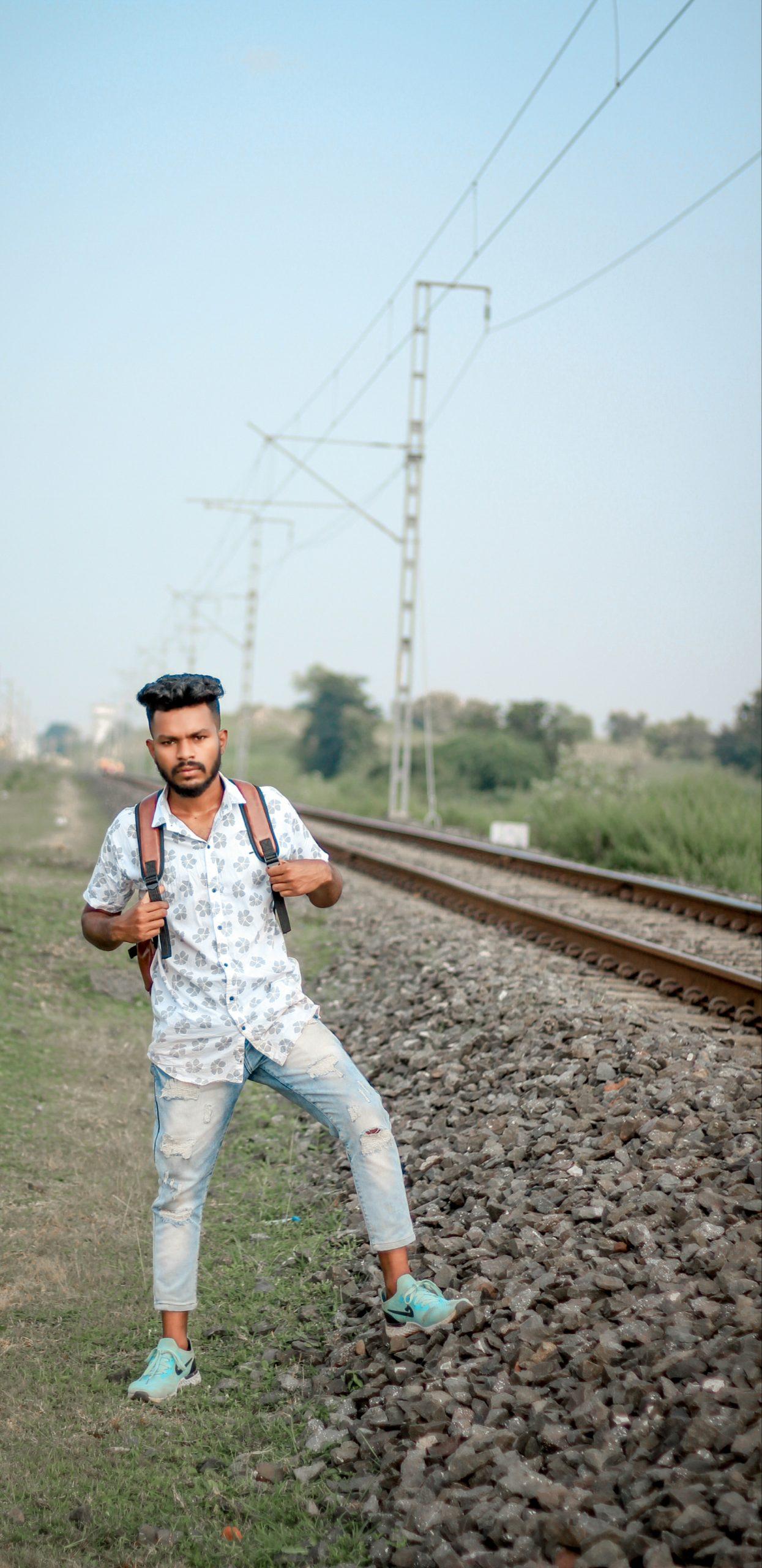 Boy posing near railway track