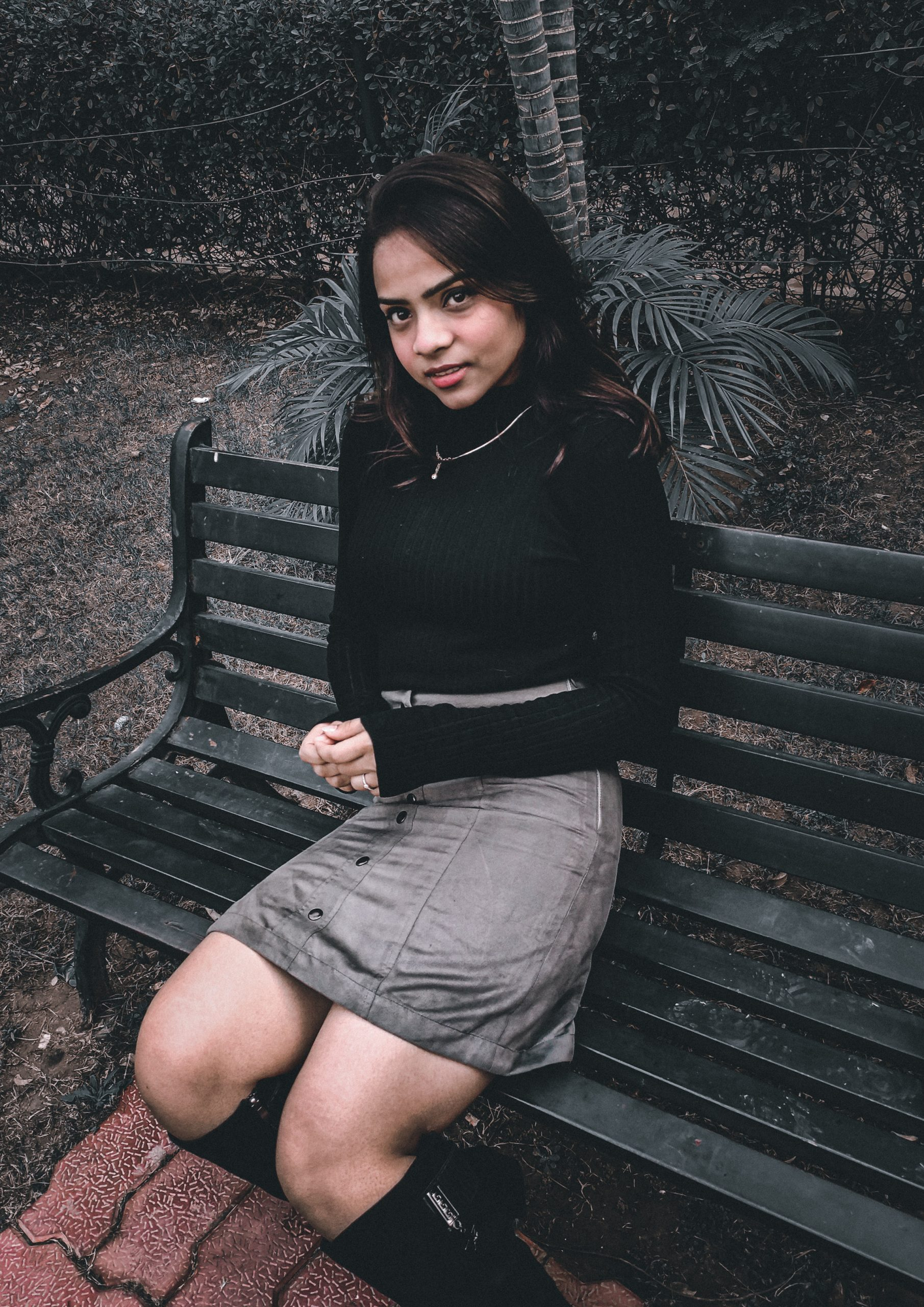 A girl on a bench
