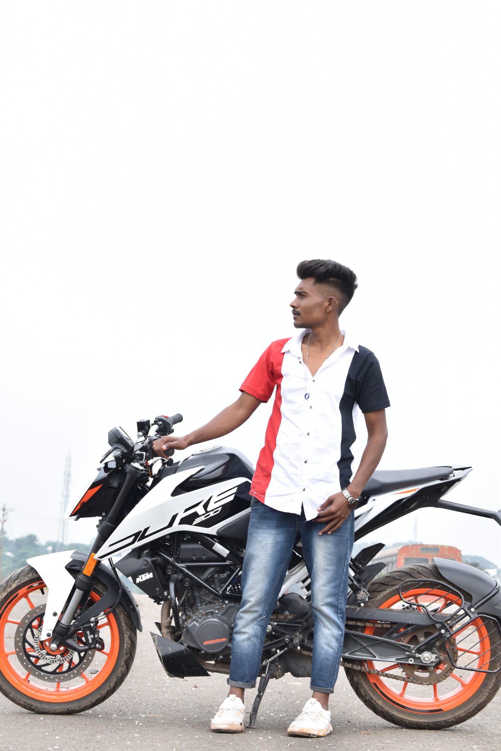 Boy posing on KTM duke bike