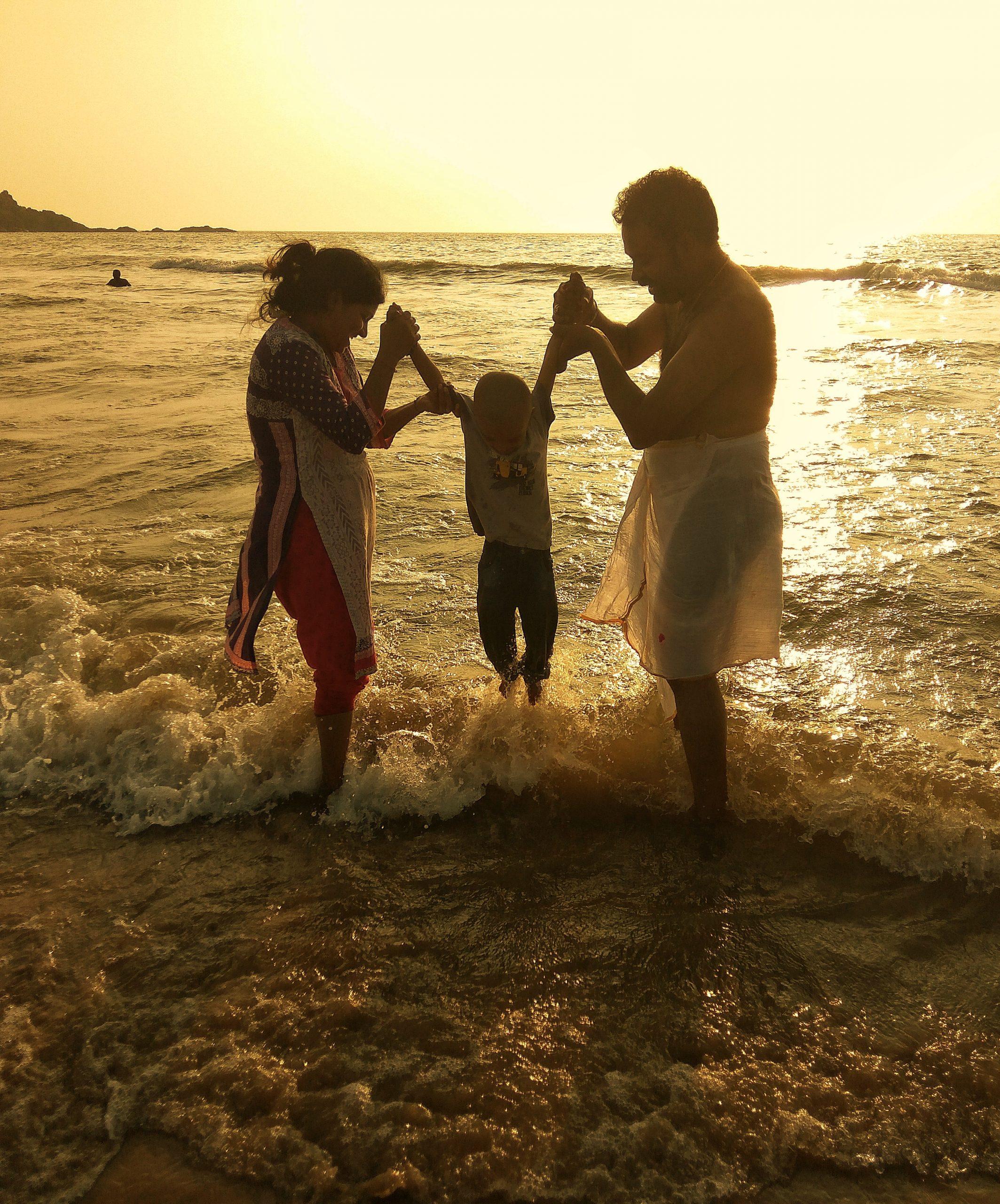 A couple with a kid on a beach