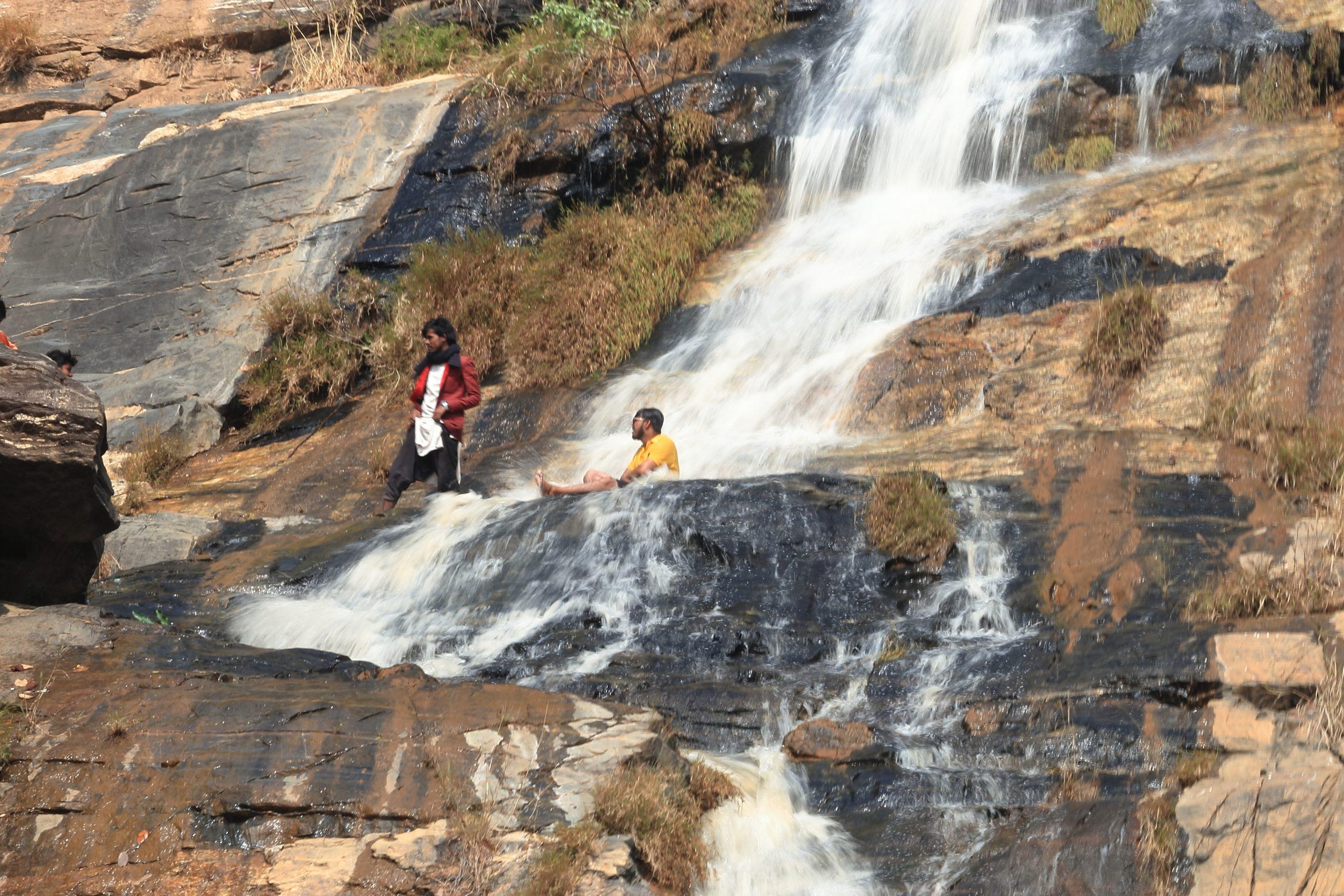 Man bathing under the waterfall