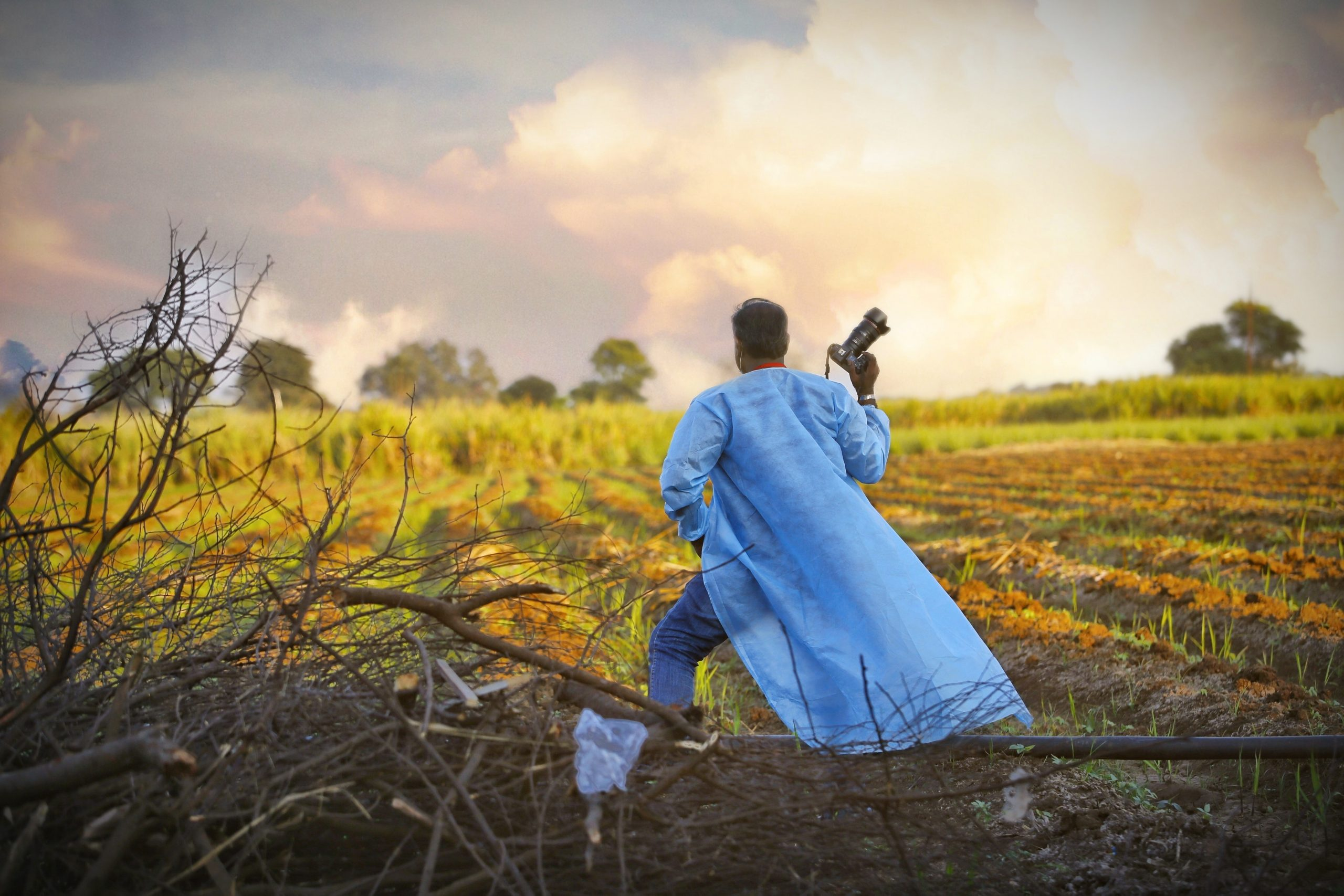 Man posing with camera in farm