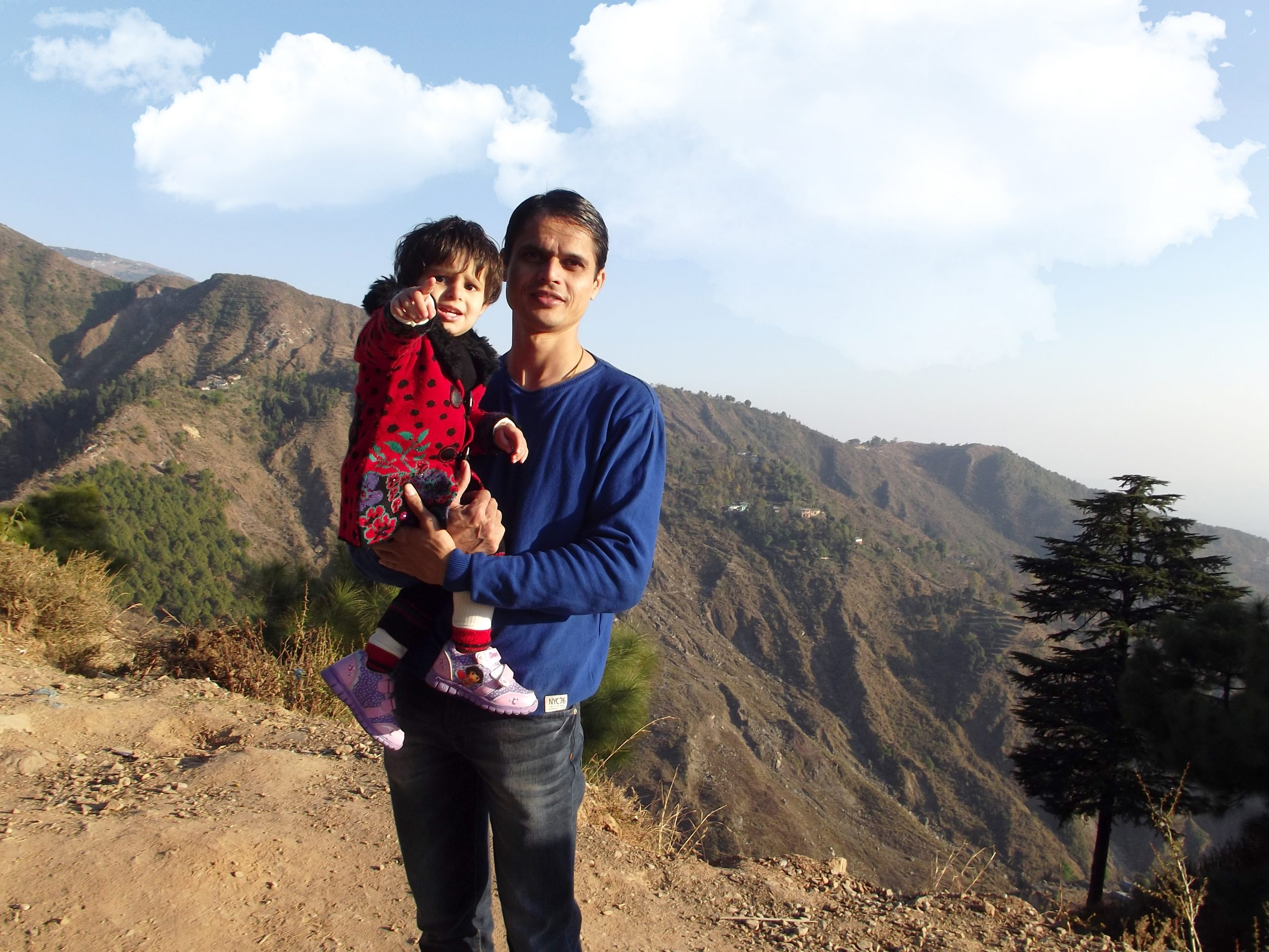 Man with baby in mountains
