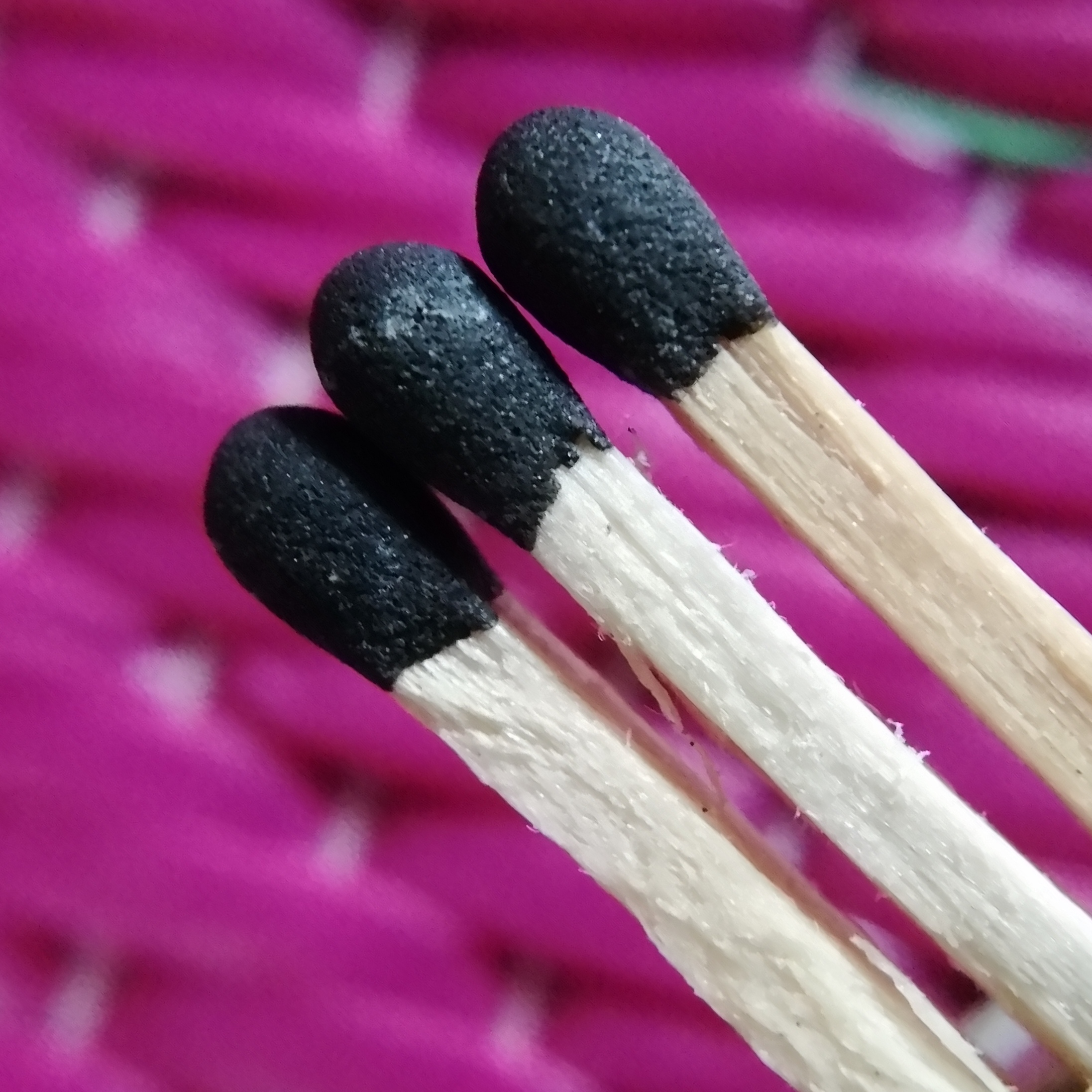 Match sticks with a pink background