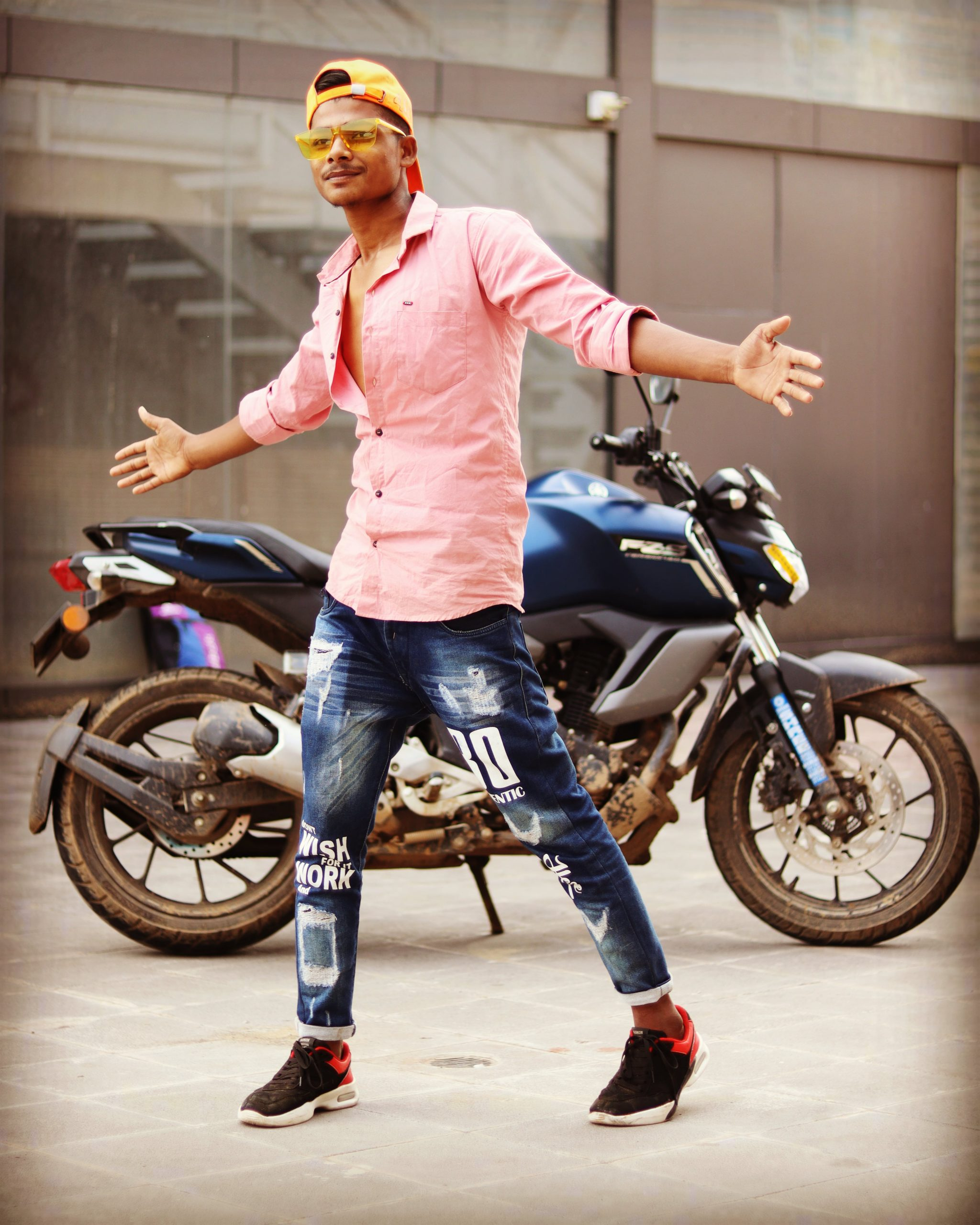 Boy posing in front of bike