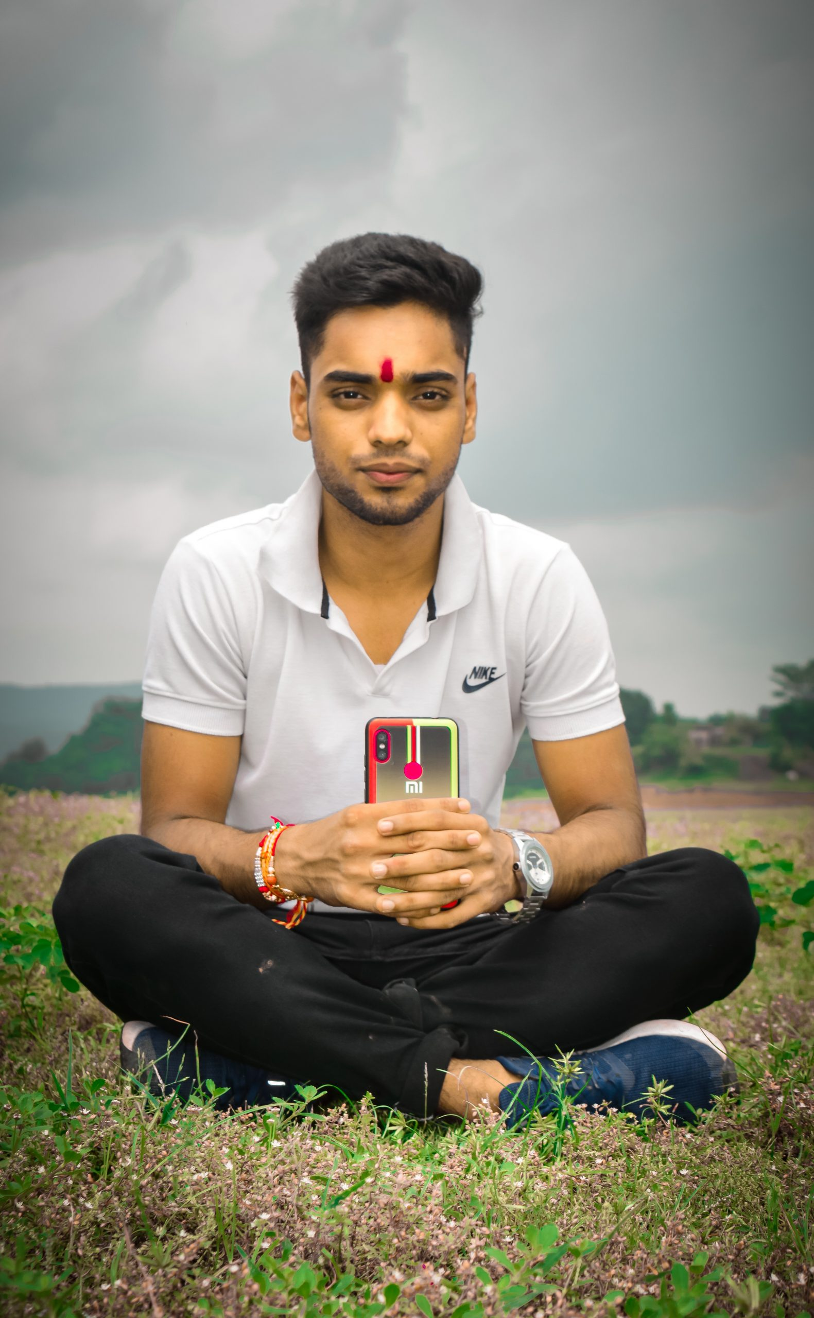A boy with phone is hand