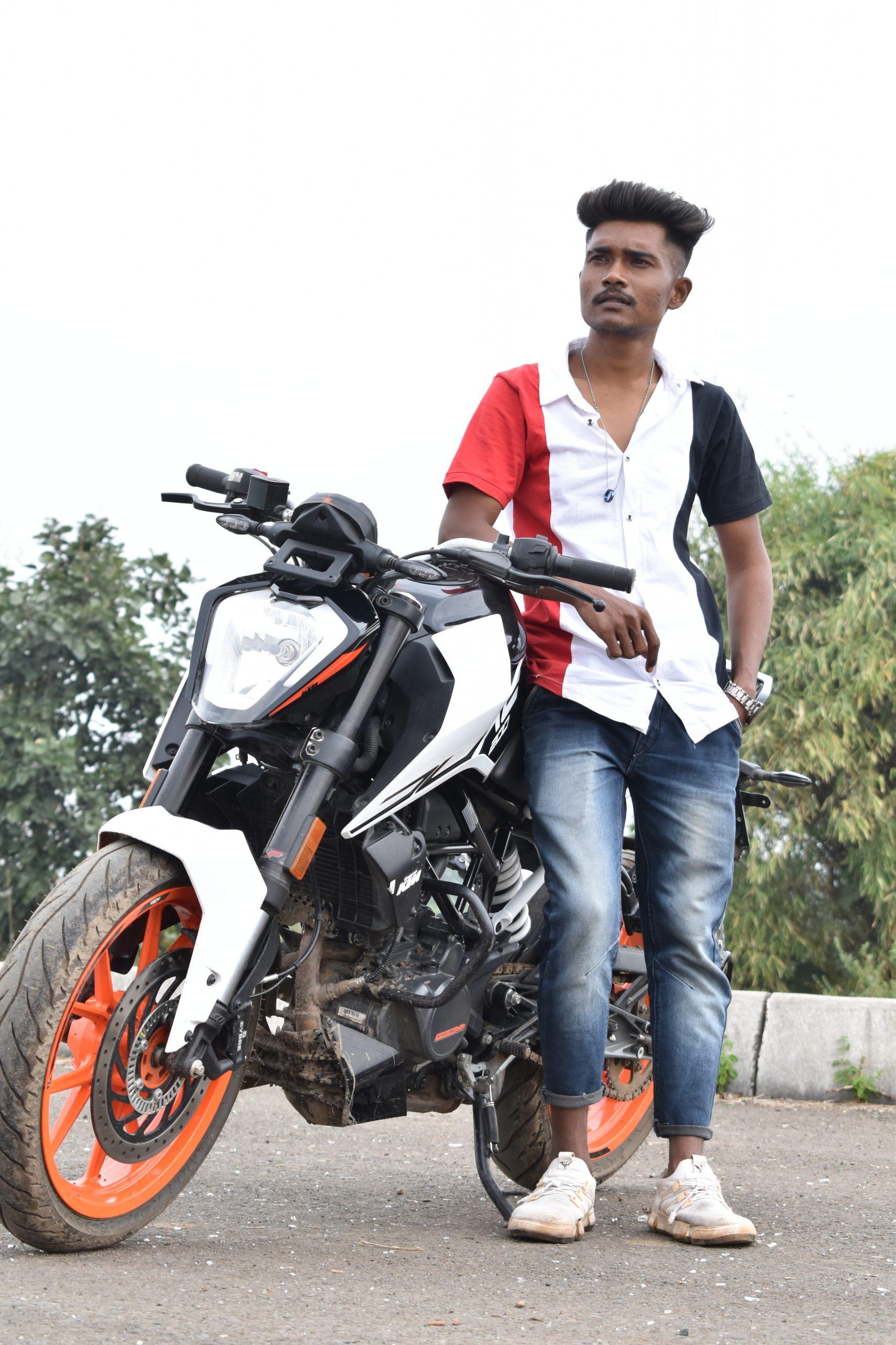 Model posing on Duke bike