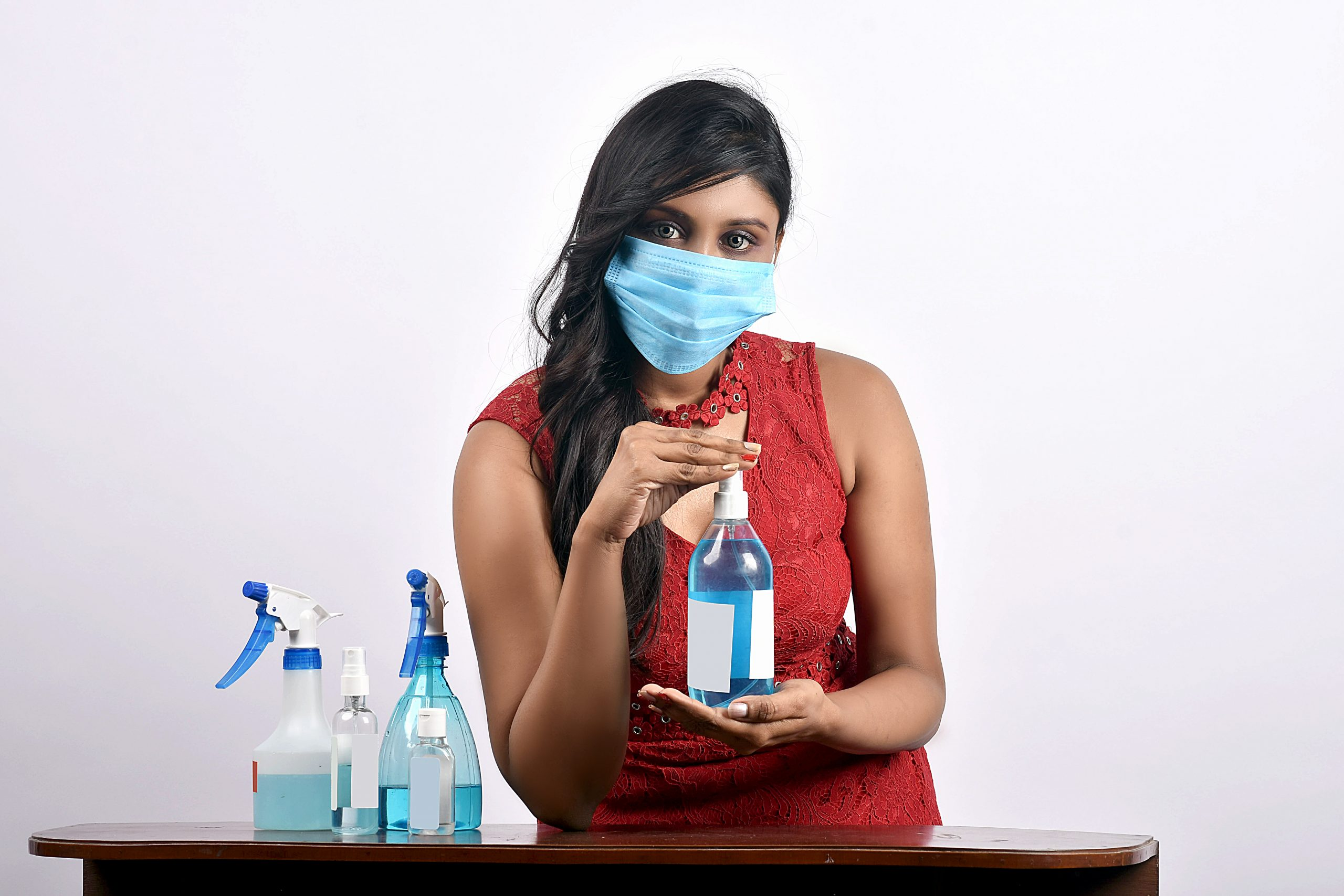 Model with mask and sanitizer